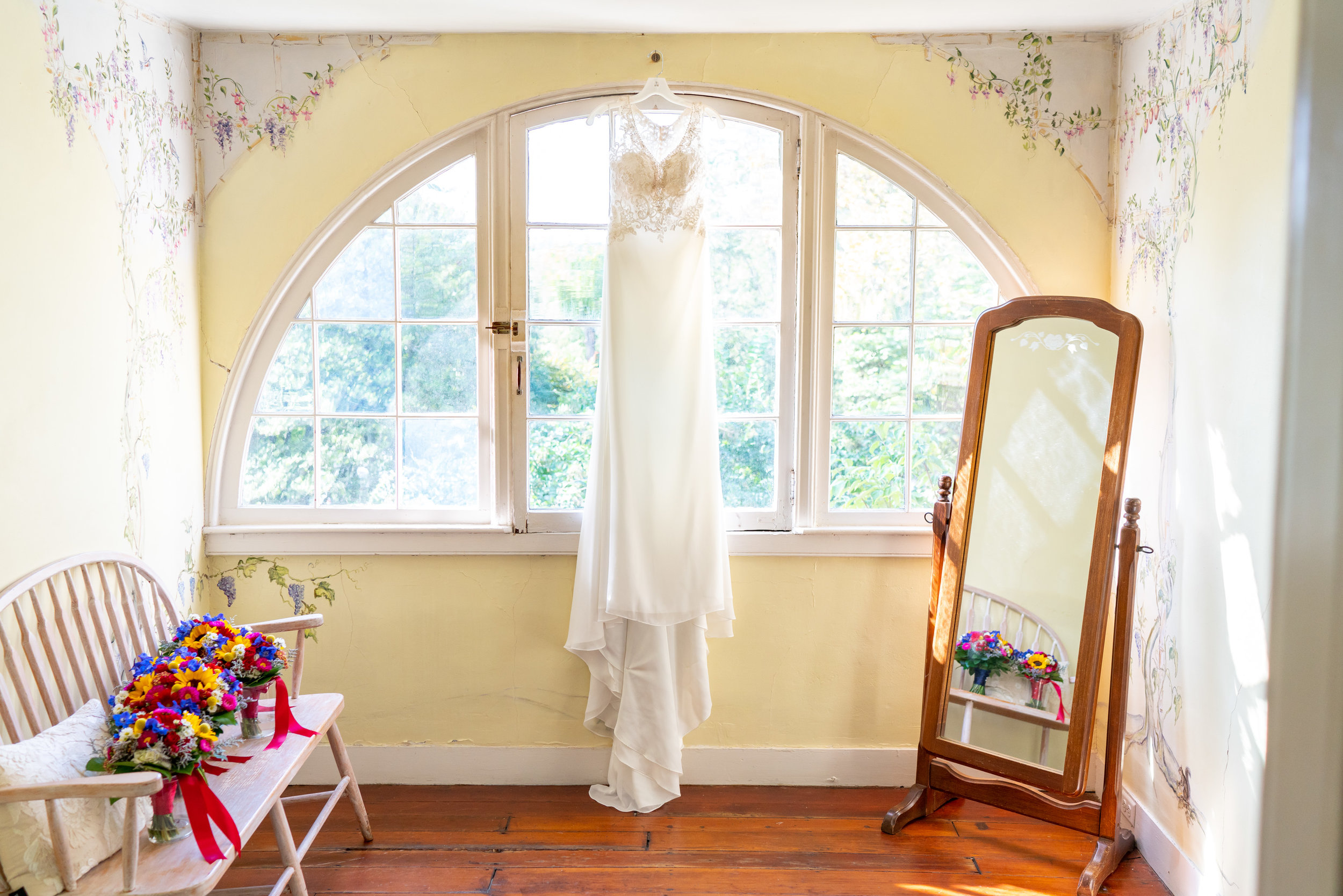 Bride's Morilee Myka gown hanging in window at Elkridge Furnace inn (similar to Keisha gown)