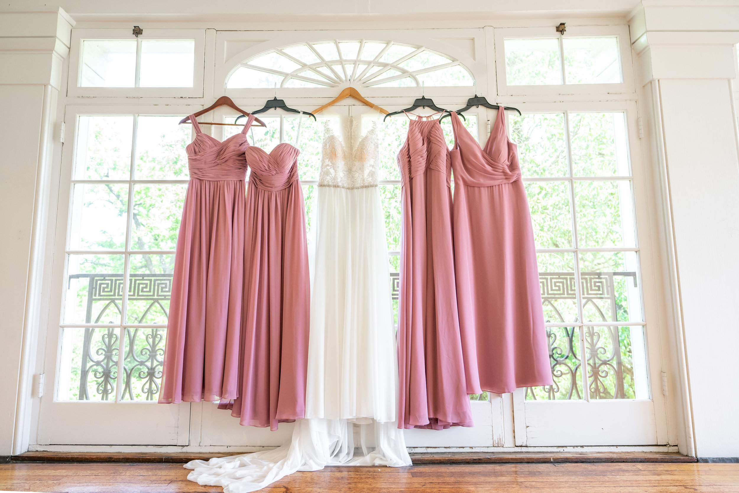 Wedding gown and bridesmaid dresses in balcony at Glenview Mansion in Rockville