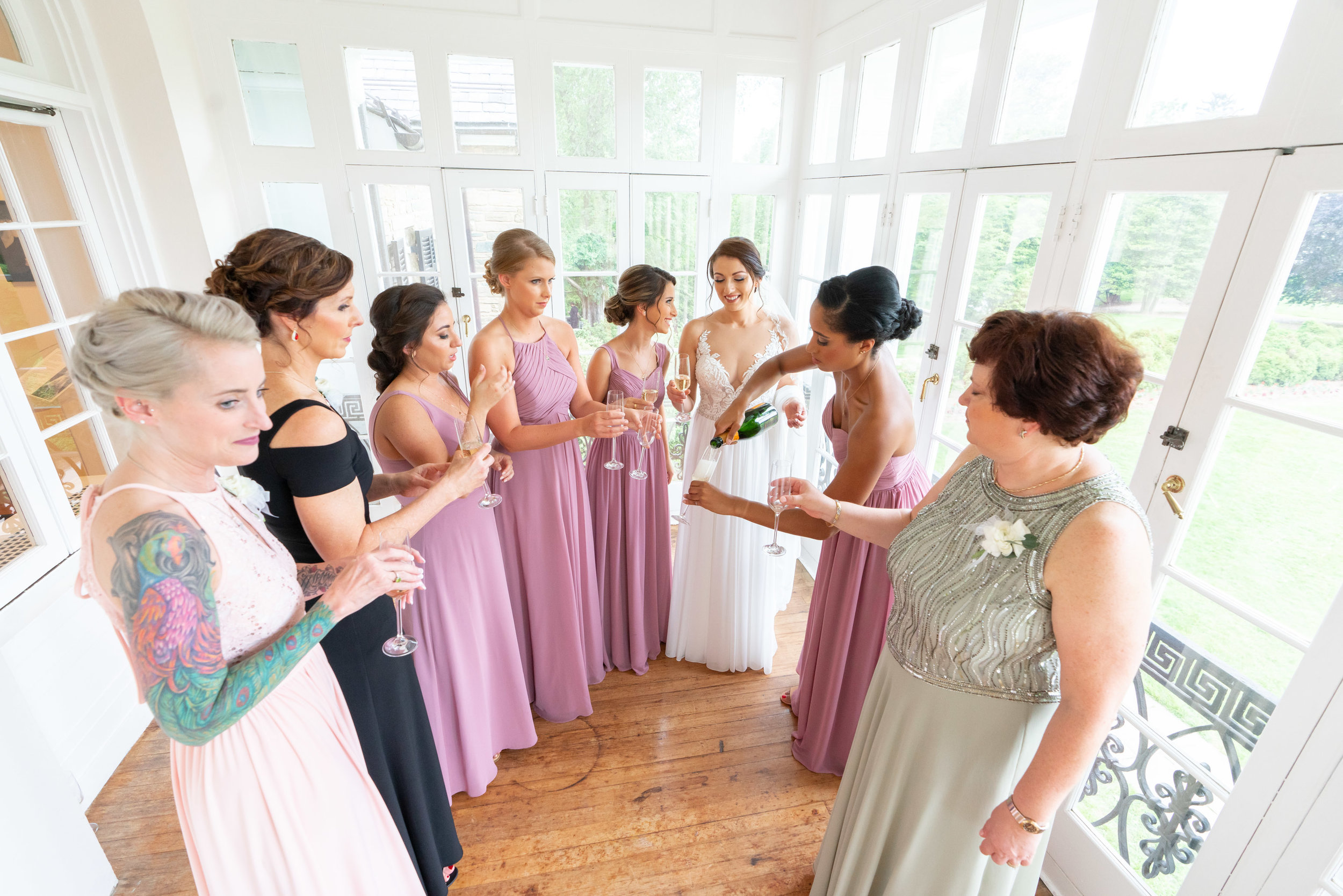 Wedding day at Rockville Glenview Mansion with bride and bridesmaids in balcony