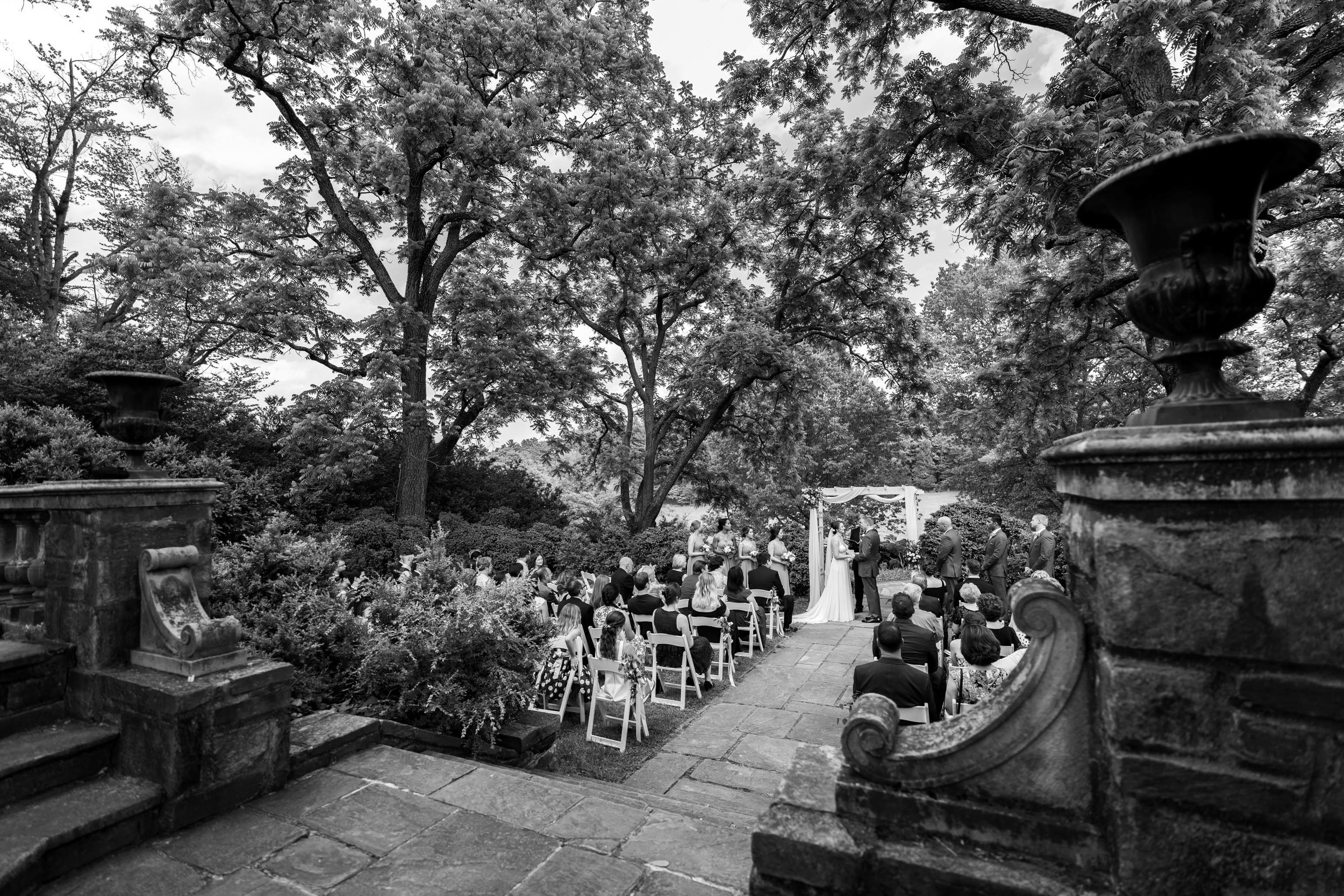 Dramatic black and white photo of Glenview Mansion's ceremony site outside