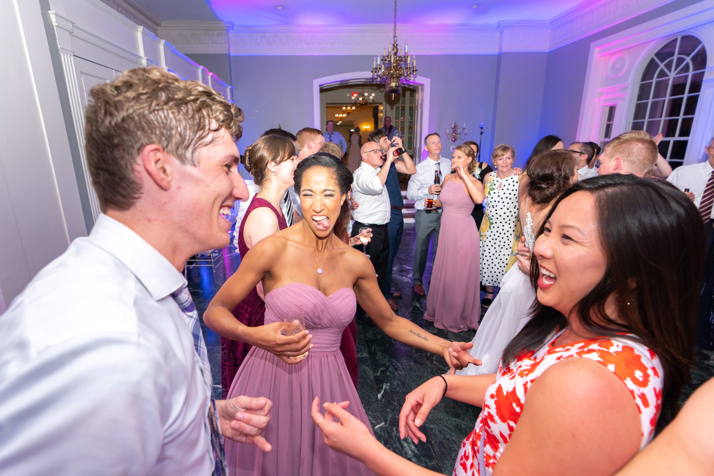 Wedding guests dancing and fun wedding photographer in washington dc