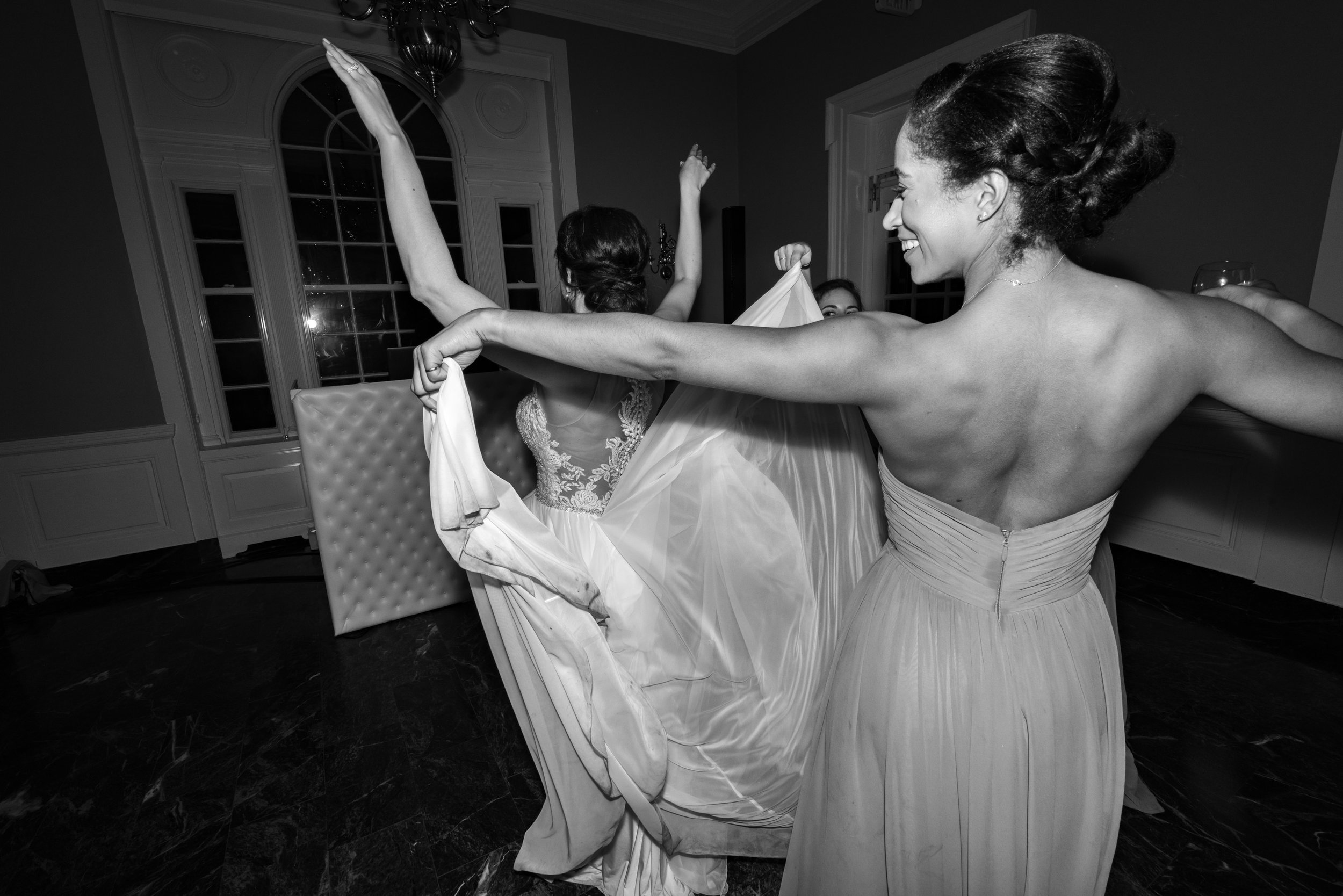 Bride and bridesmaids partying during wedding reception at Rockville wedding venue Glenview Mansion