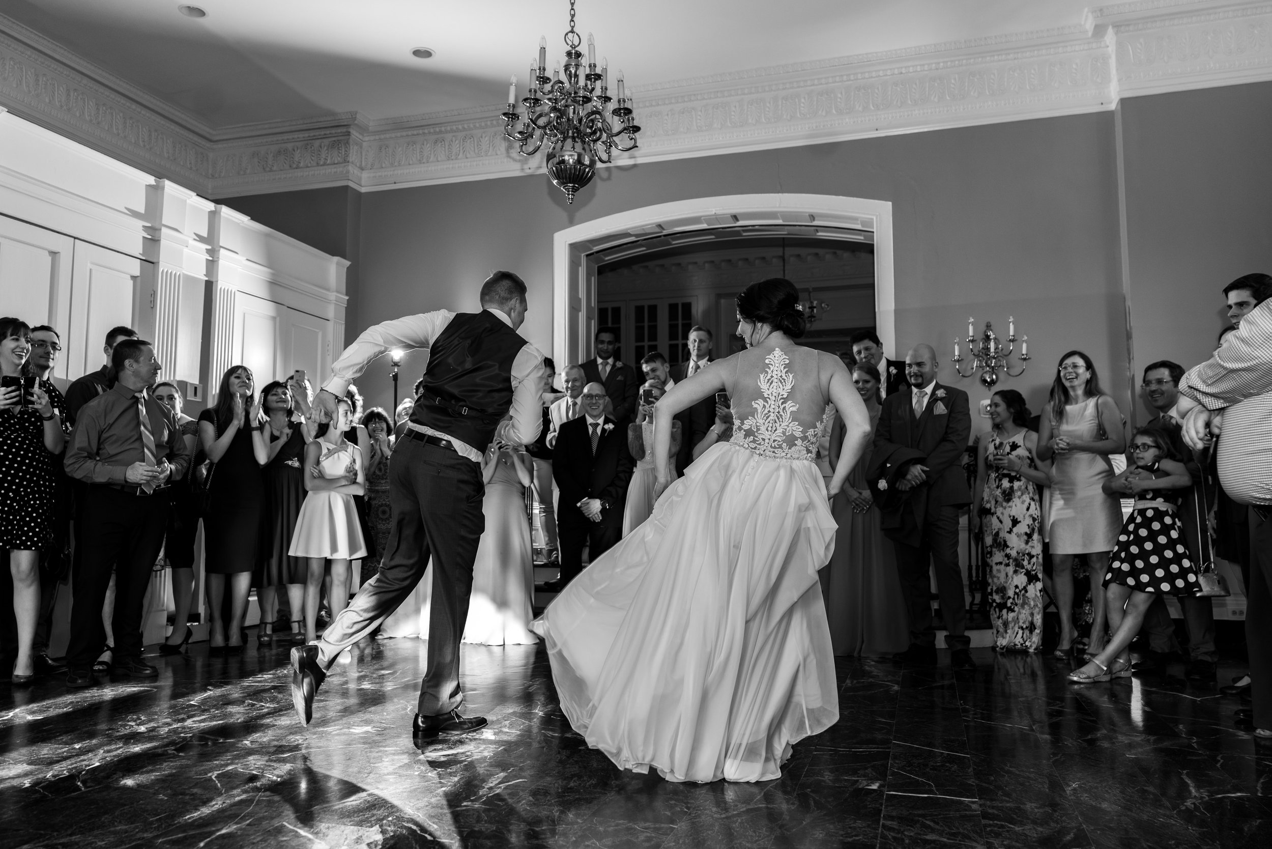 Bride and groom first dance in black and white in Rockville Maryland wedding venue
