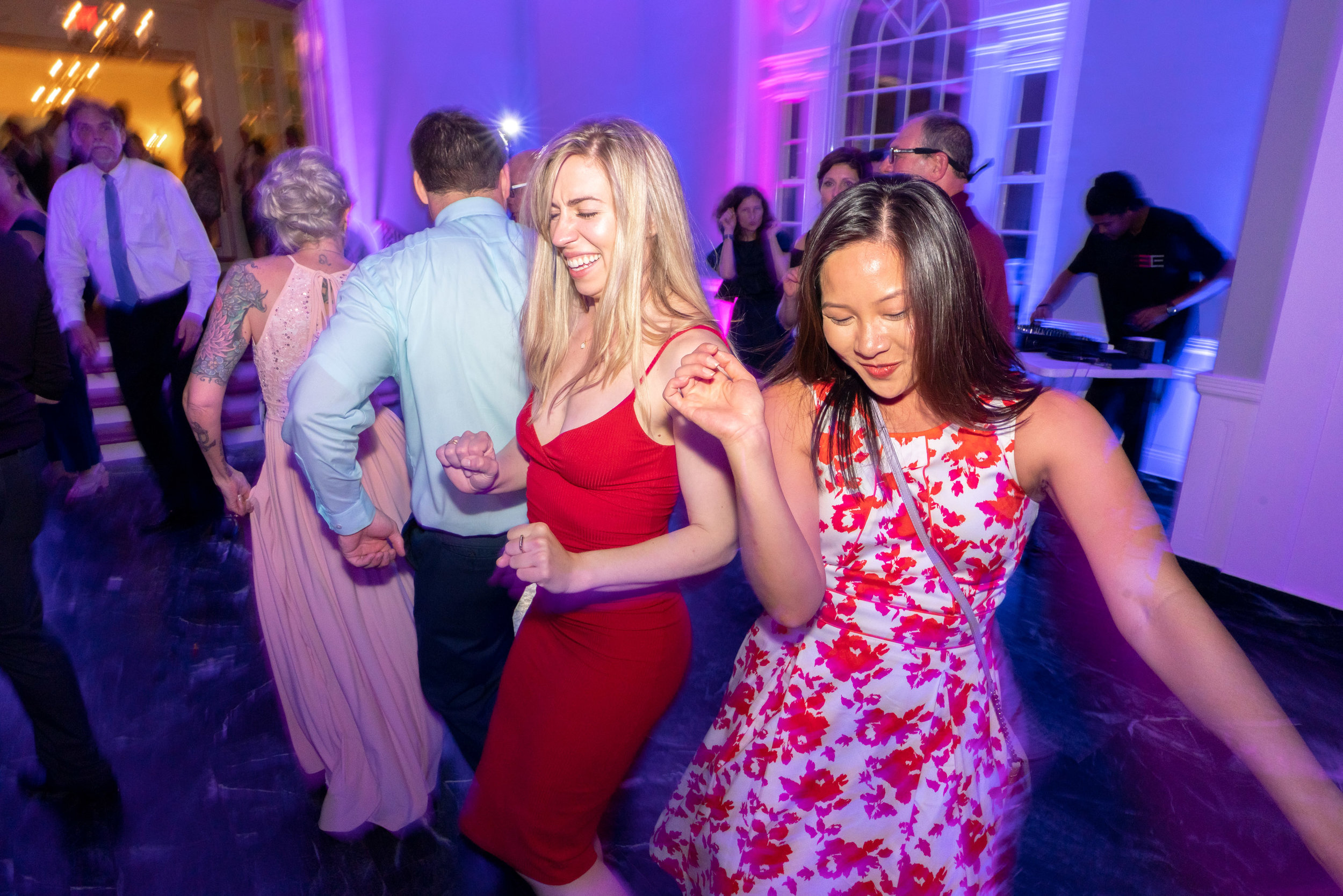 Guests dancing at Glenview Mansion during wedding reception in the ballroom