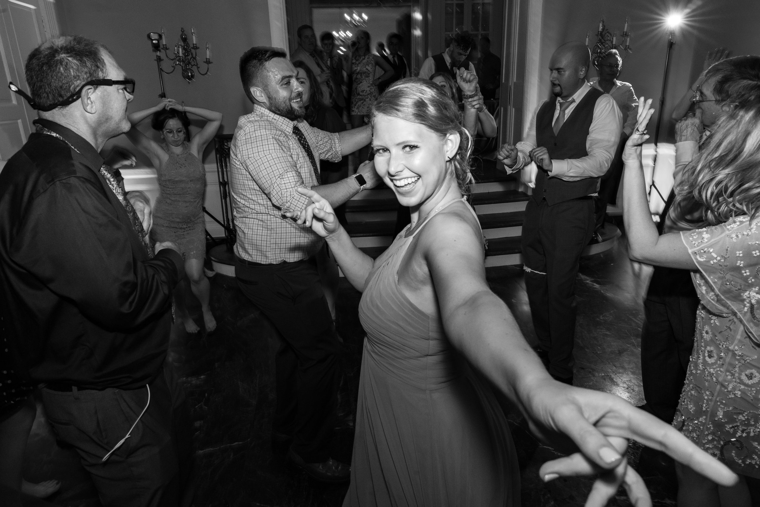 Bridesmaid laughing at the camera during wedding reception at Glenview Mansion