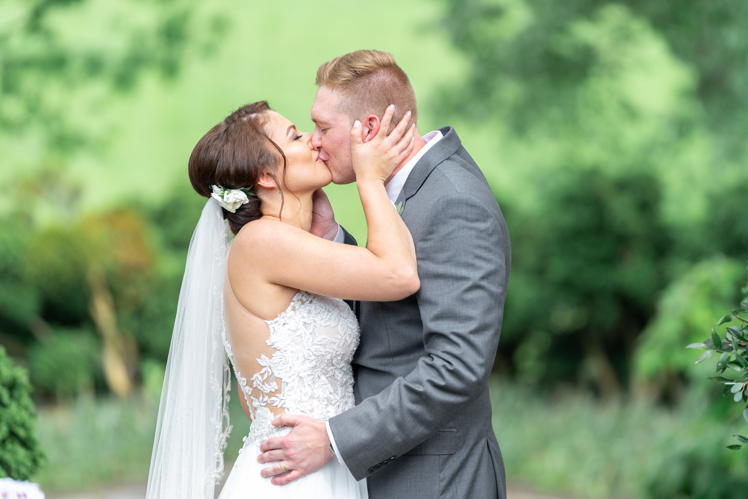 Bride and groom kiss at Glenview Mansion ceremony site