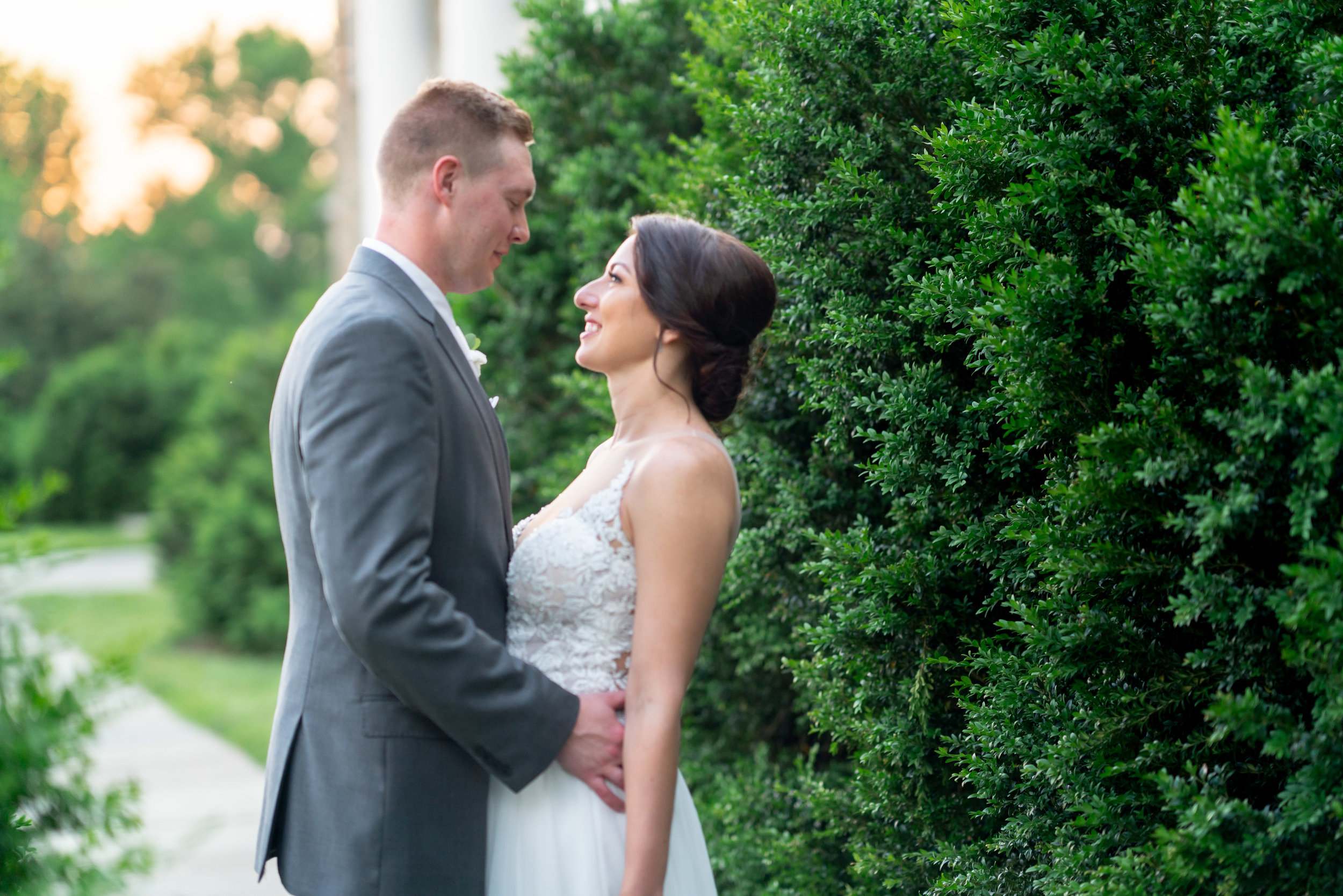 Golden hour sunset wedding portraits of bride and groom at Glenview Mansion