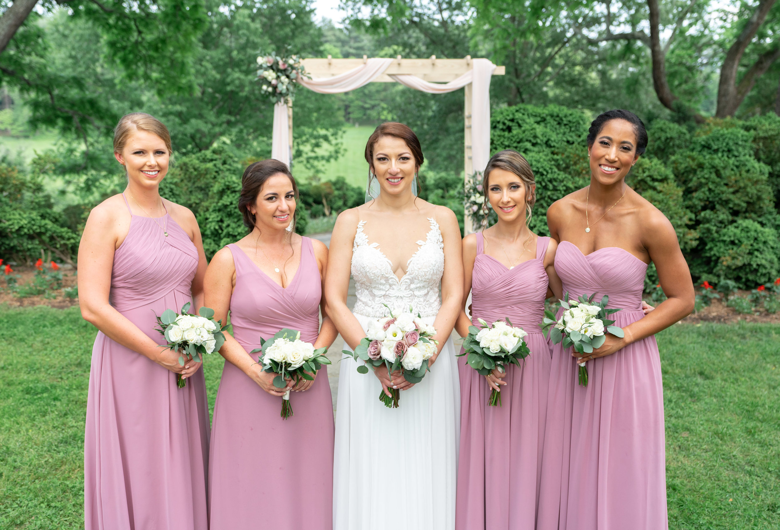 Bride and bridesmaids wearing dusty pink at Glenview Mansion