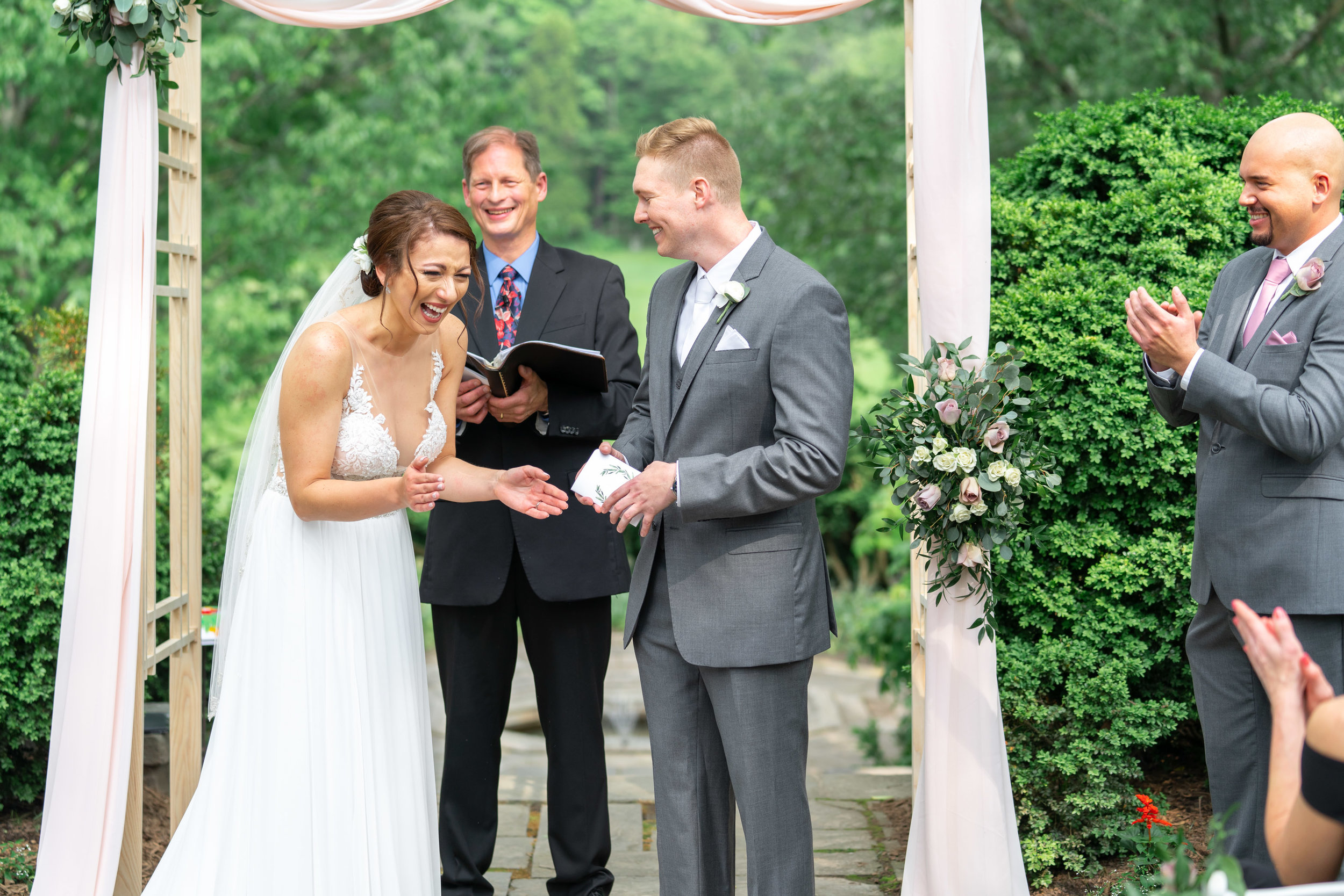 Bride and groom laughing during vows at Glenview Mansion wedding photography