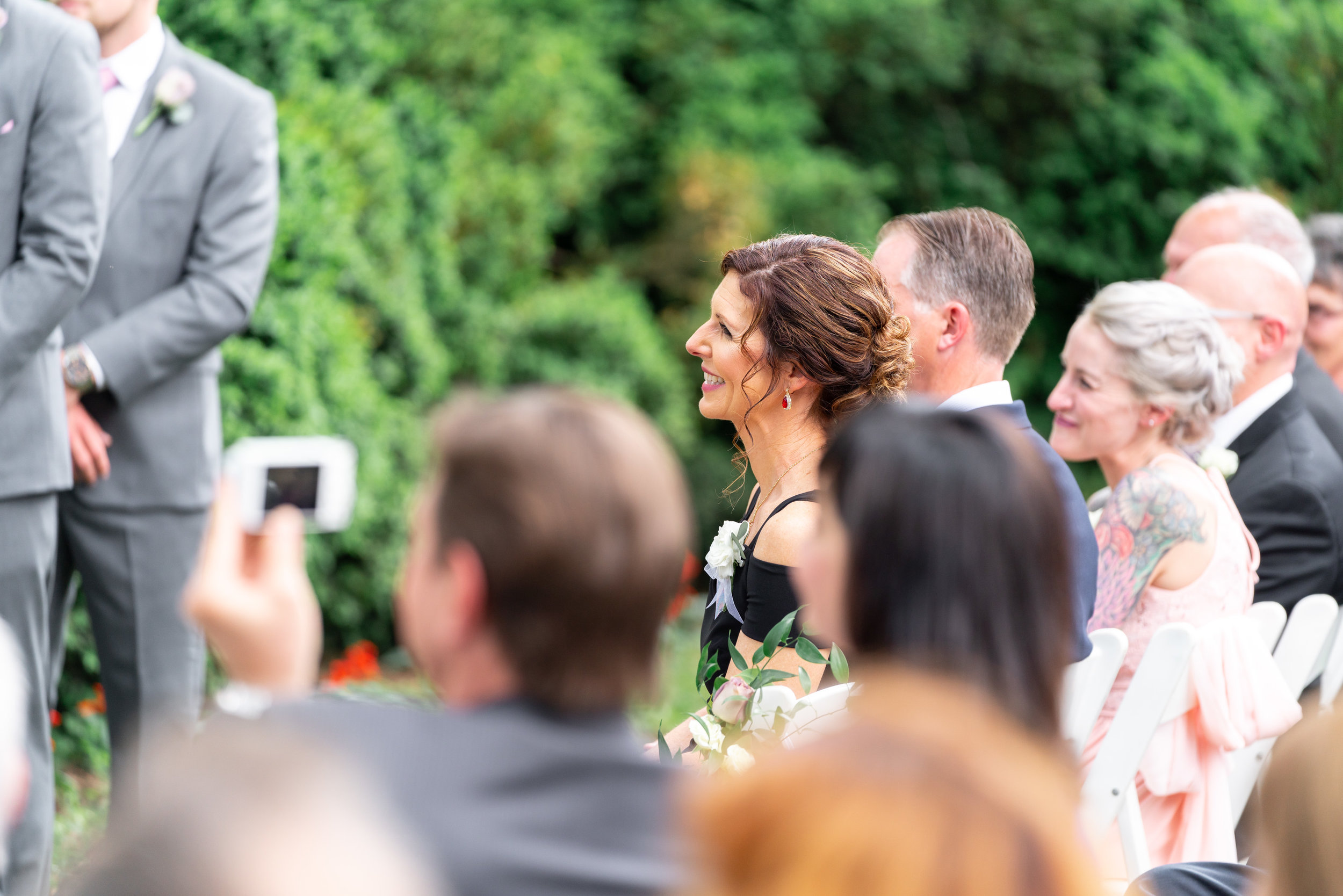 Mother of the groom watches wedding ceremony at Rockville's Glenview Mansion