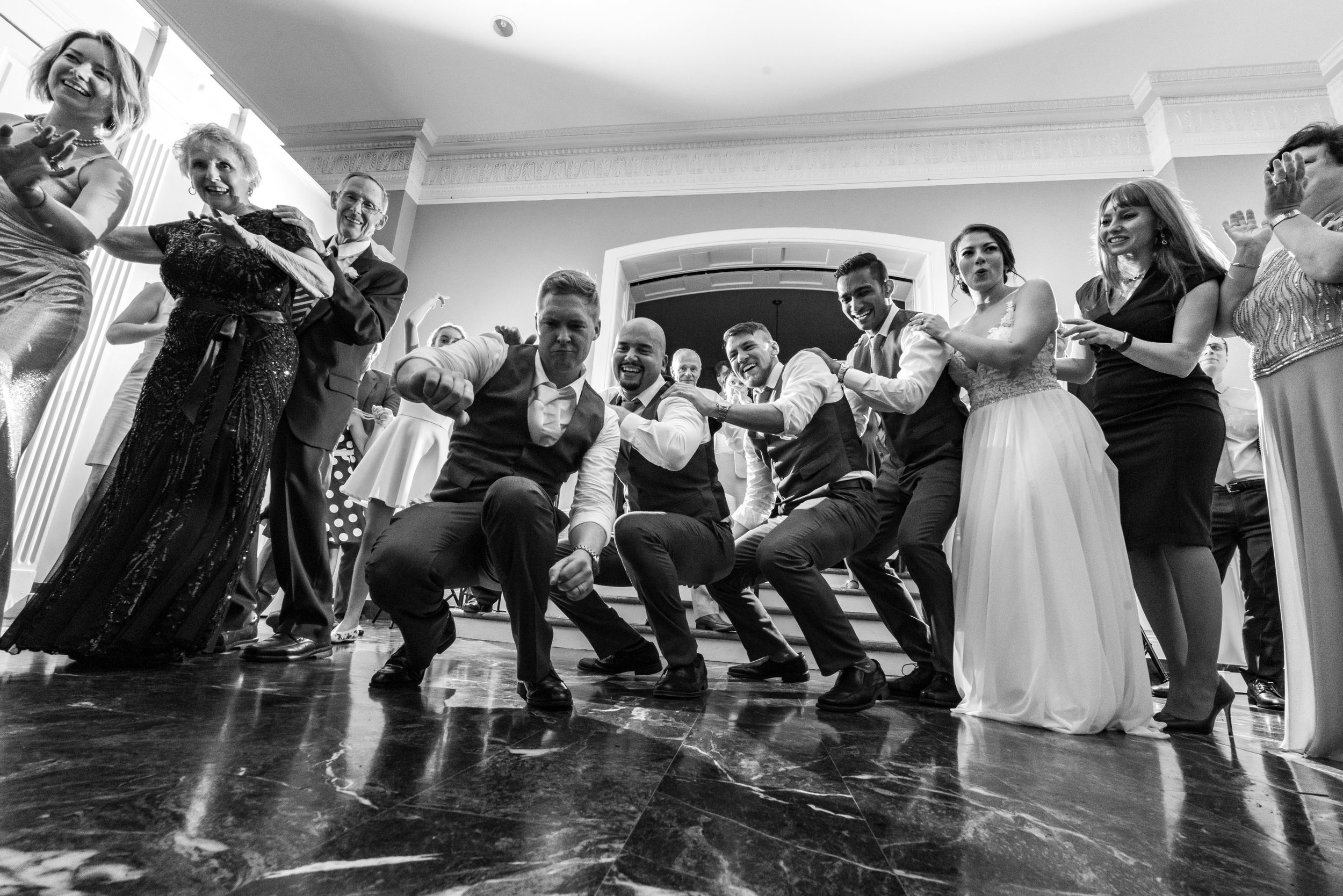 Groom and groomsmen dancing as photographed by Washington DC fun wedding photographer