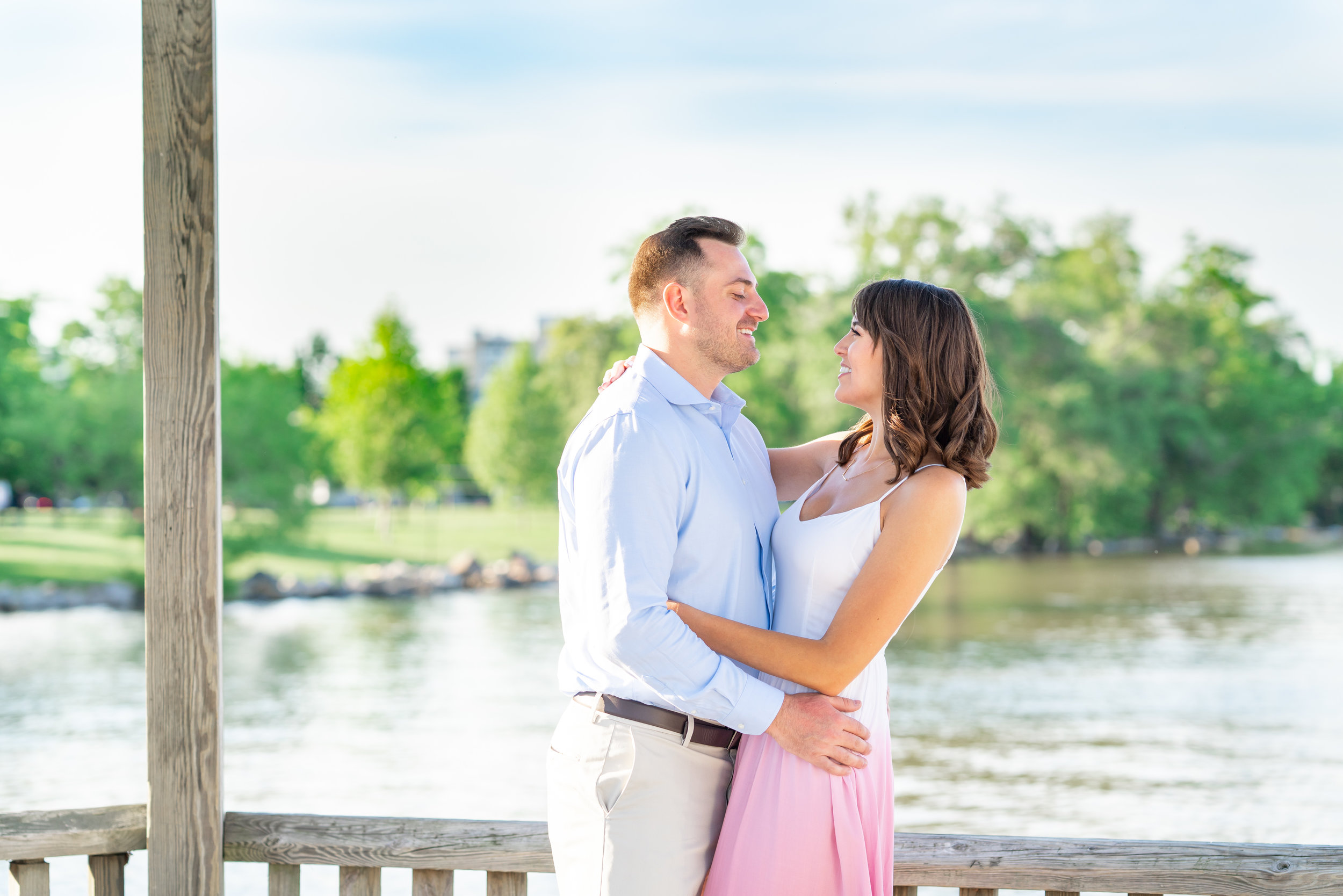 waterfront engagement photos on the dock with bride and groom