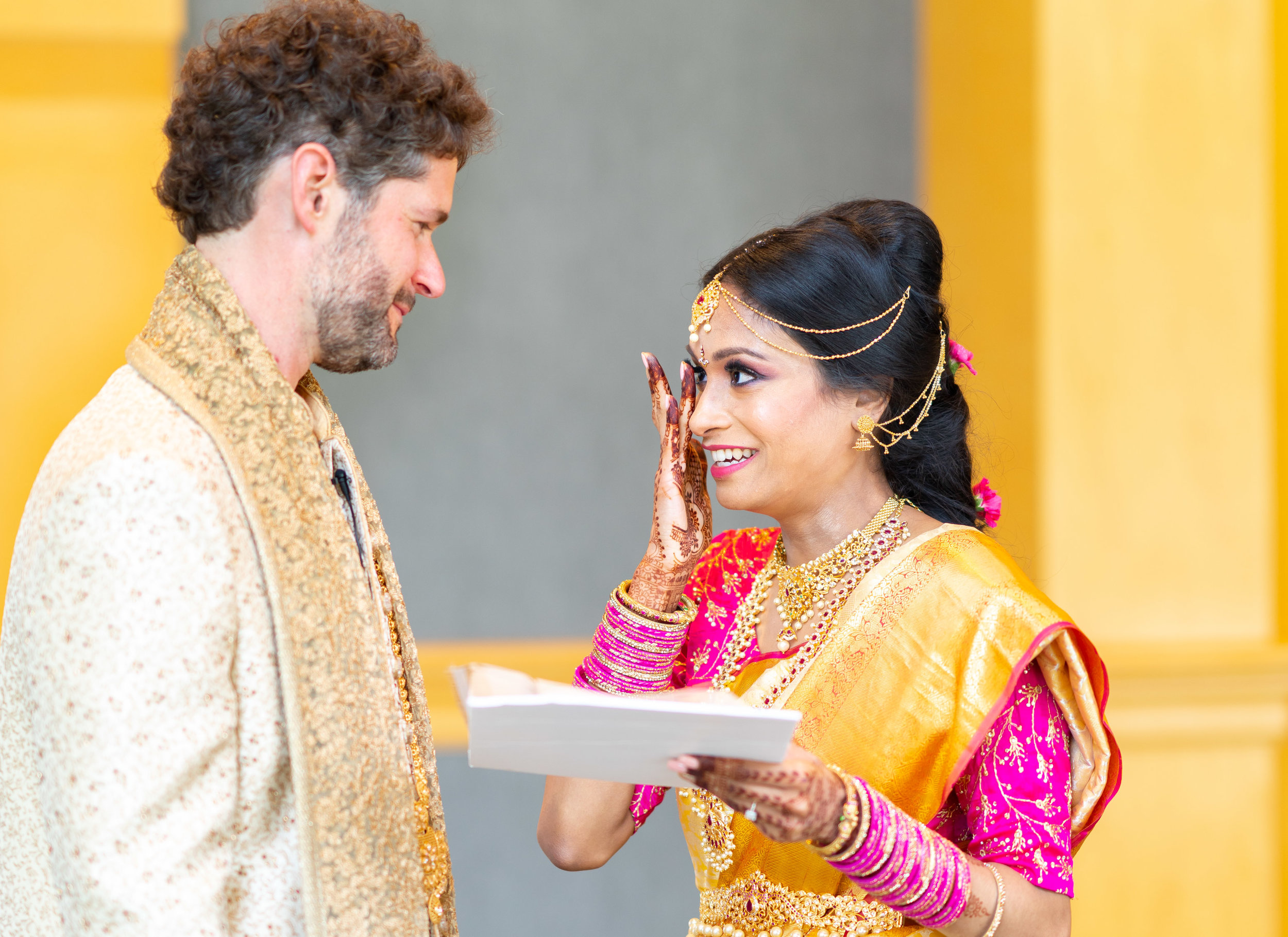 Indian bride crying while reading vows during first look