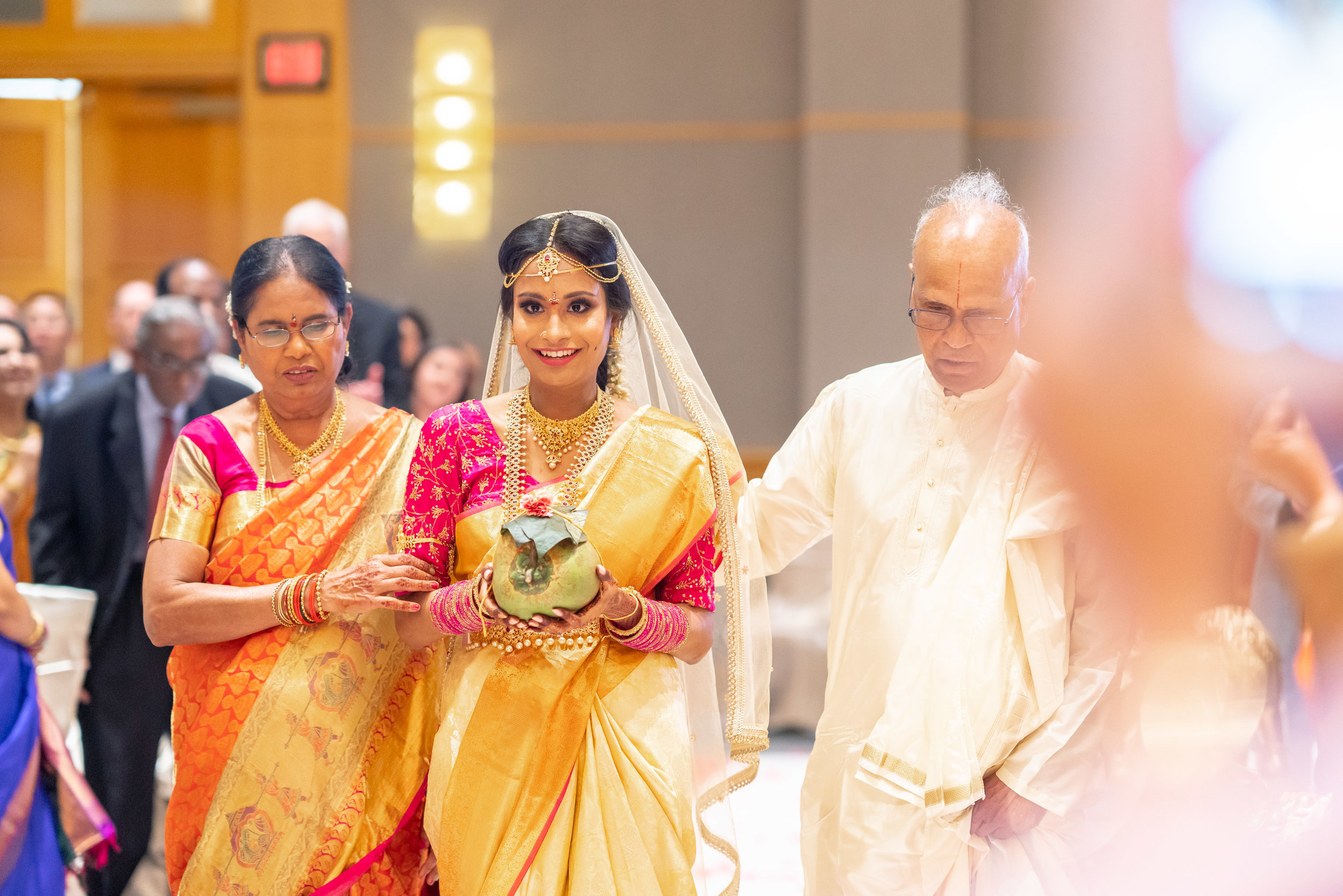 Indian bride walking down the aisle at bethesda north marriott wedding