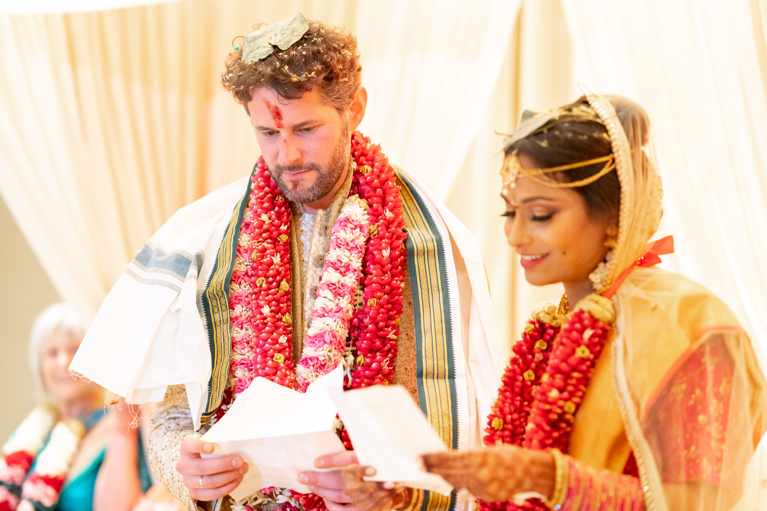 Bride reading traditional indian vows during wedding ceremony at bethesda north marriott