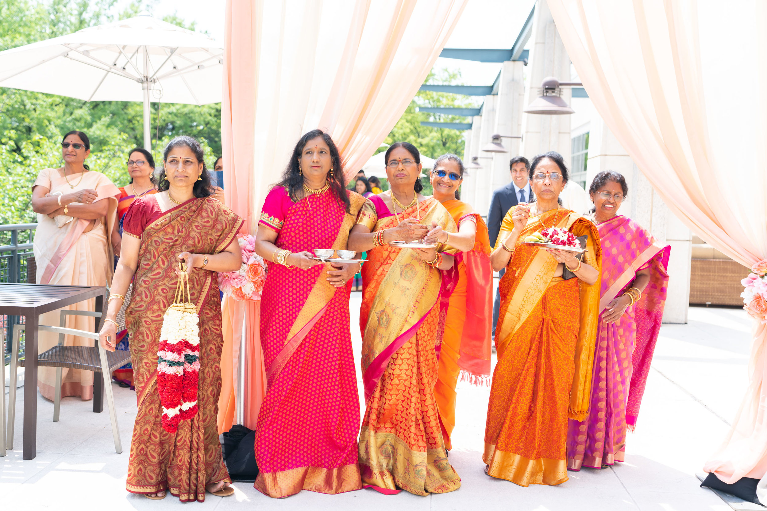 Indian mother and aunties waiting for the groom at the baraat