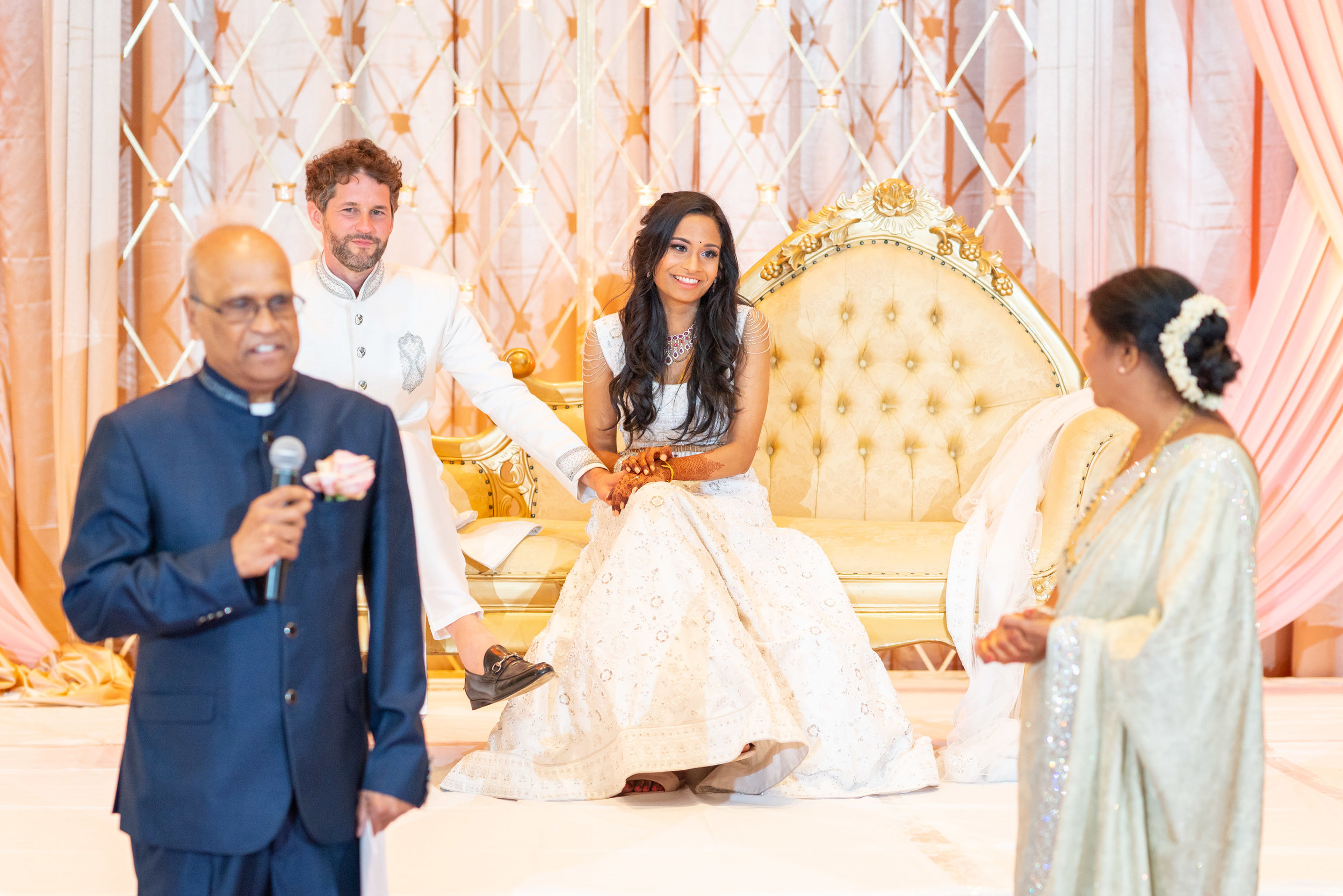 Indian parents giving speech during wedding reception