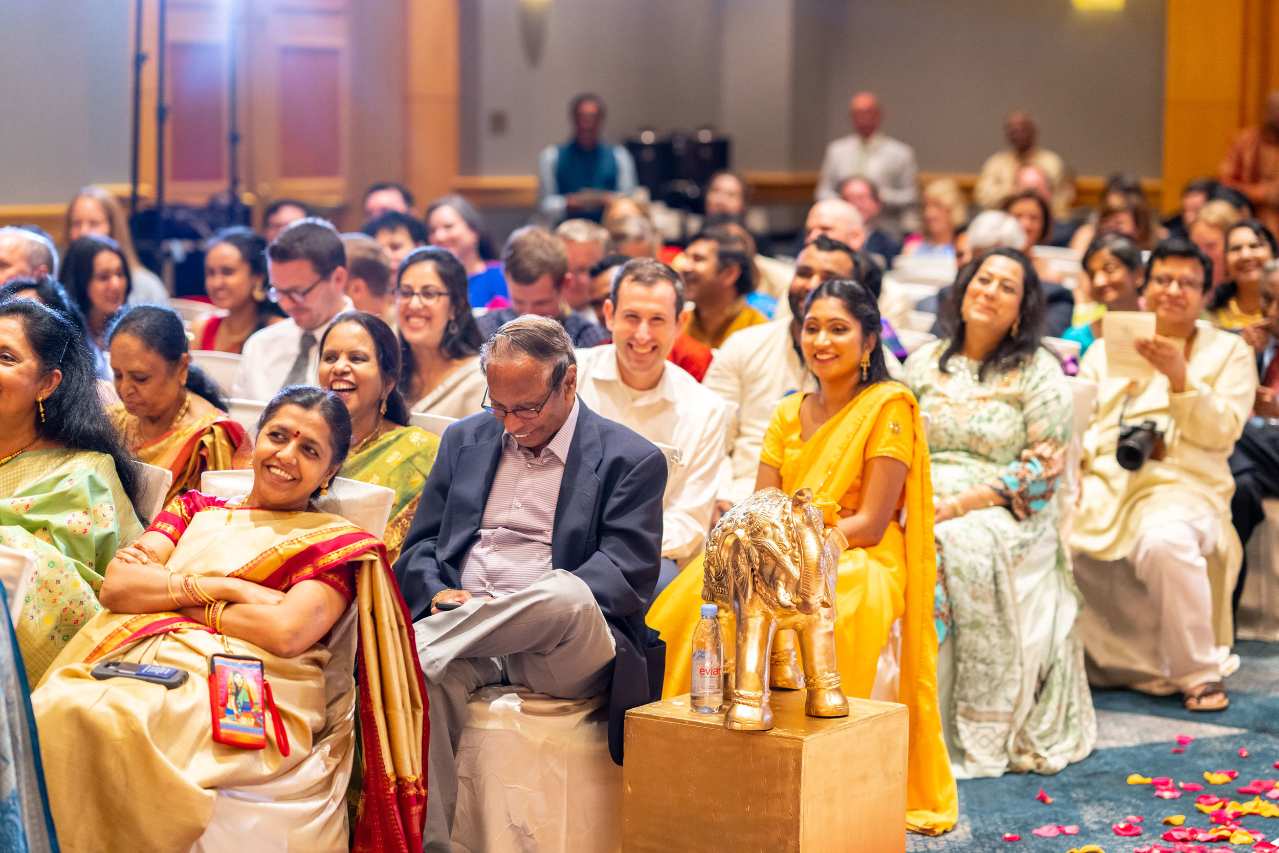 Crowd laughing at bride's vows during indian wedding in dc
