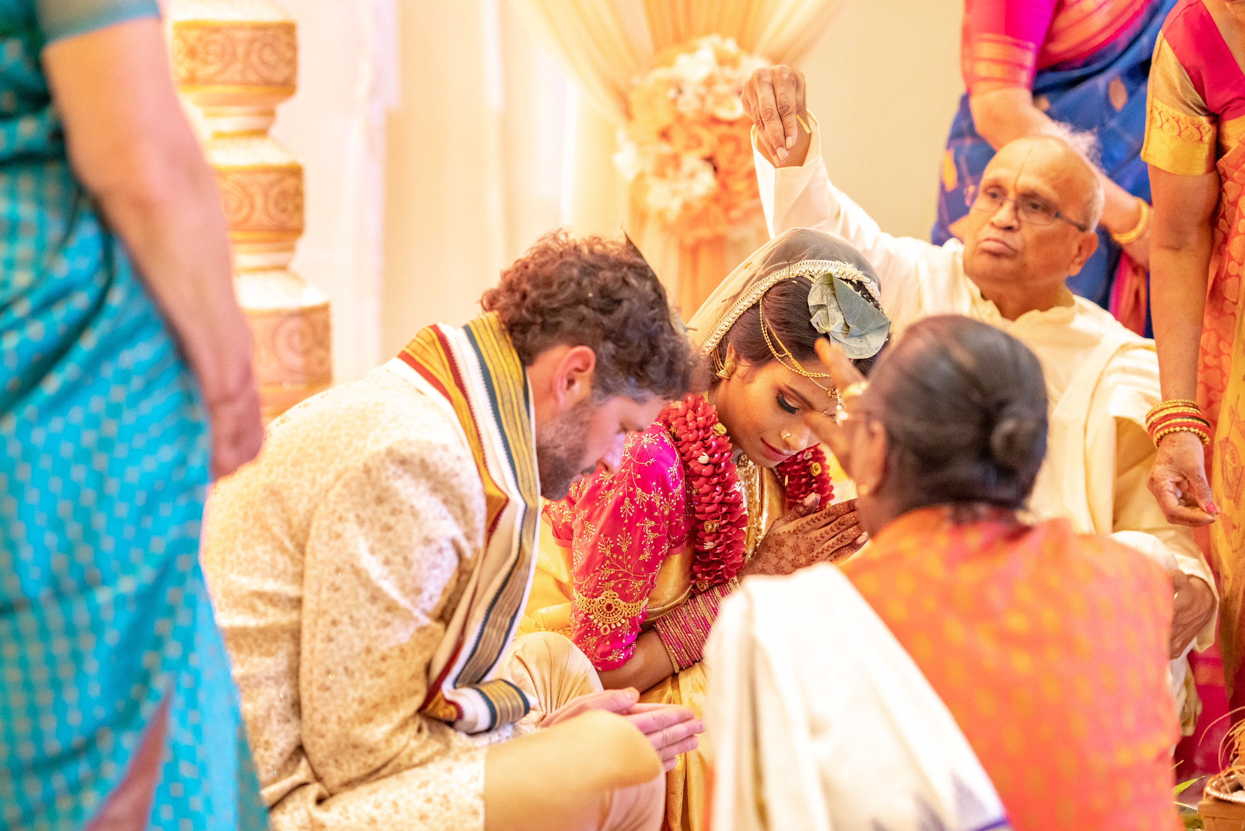 bride and groom bowing during indian wedding ceremony