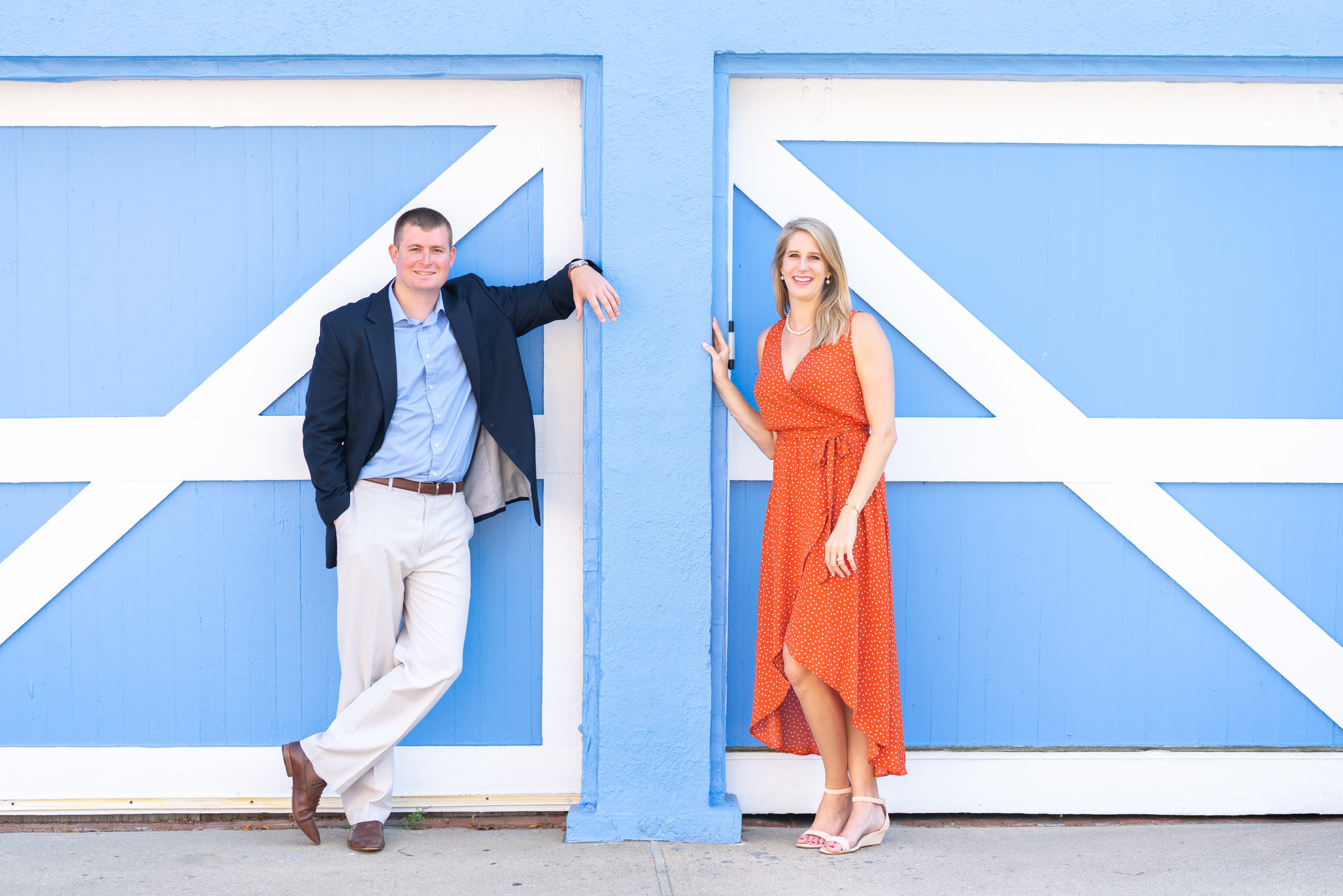 Engagement photos in Annapolis in front of blue wall