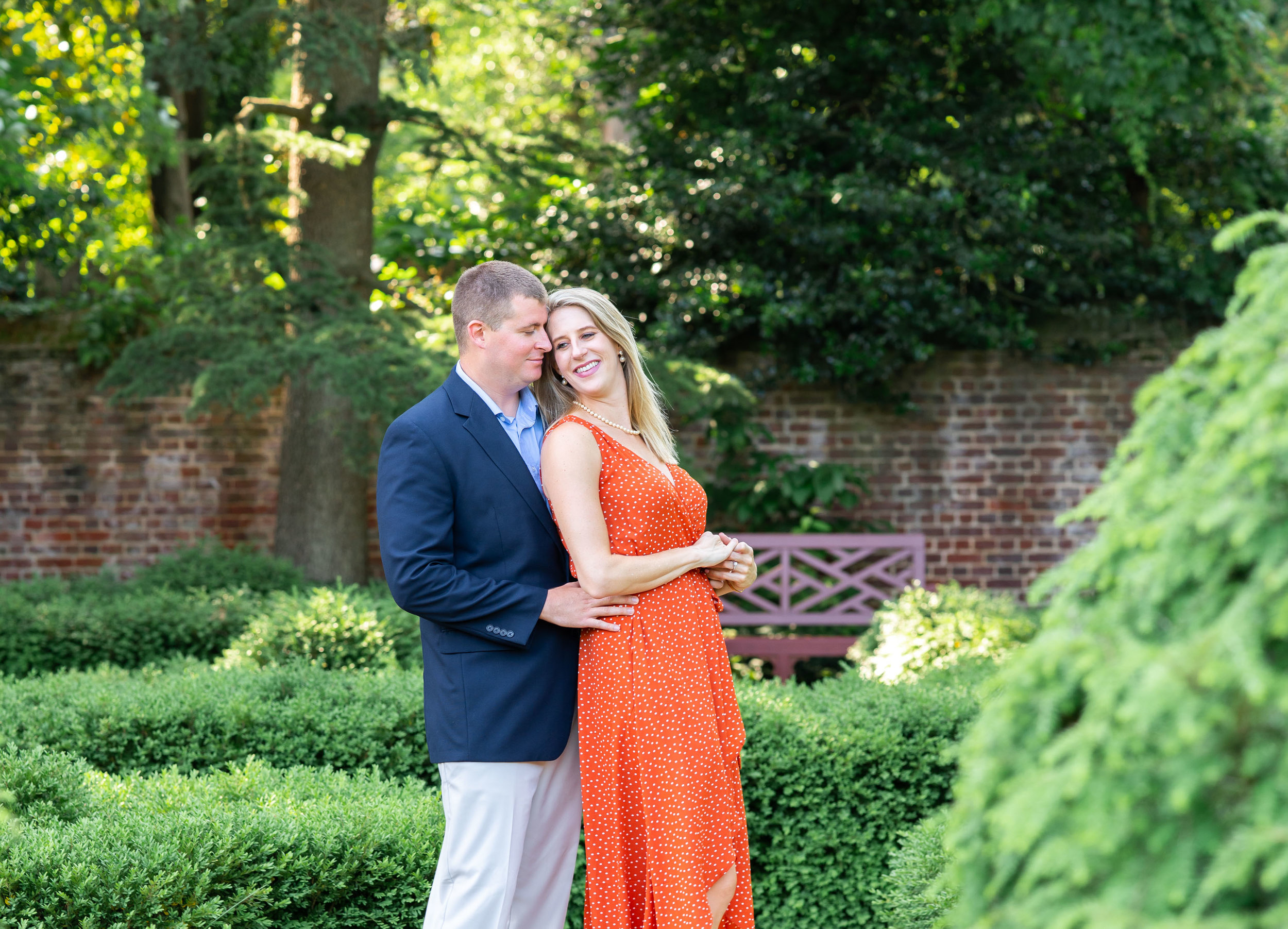 Engaged couple posing in gardens at William Paca House