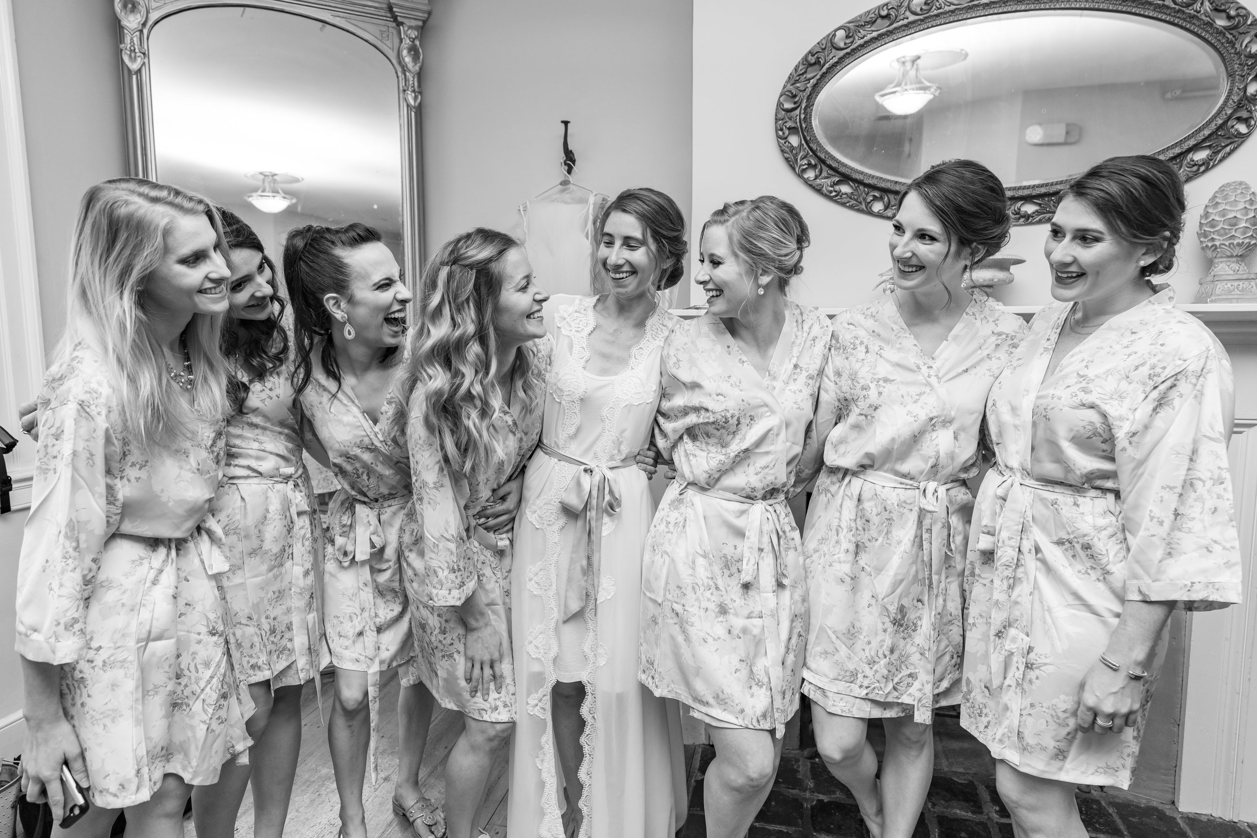 Bride and bridesmaids in matching floral robes in bridal suite at Springfield Manor Winery
