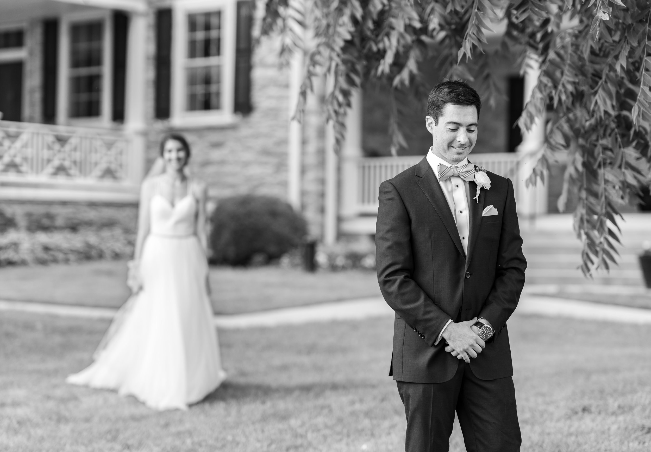 Bride and groom first look in Theia gown at Springfield Manor front lawn