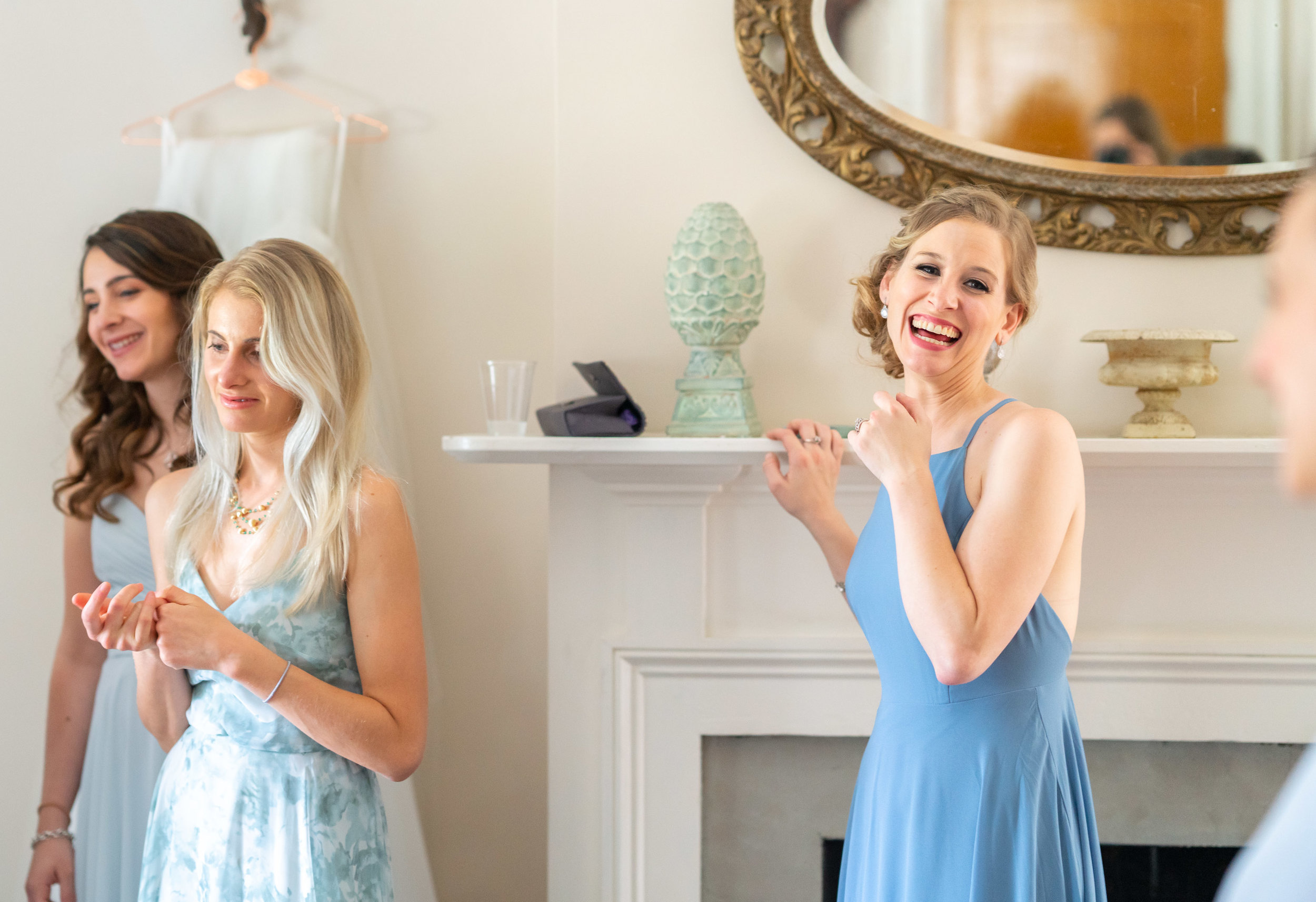 Bridesmaids laughing and crying in bridal suite at Springfield Manor Winery and Distillery