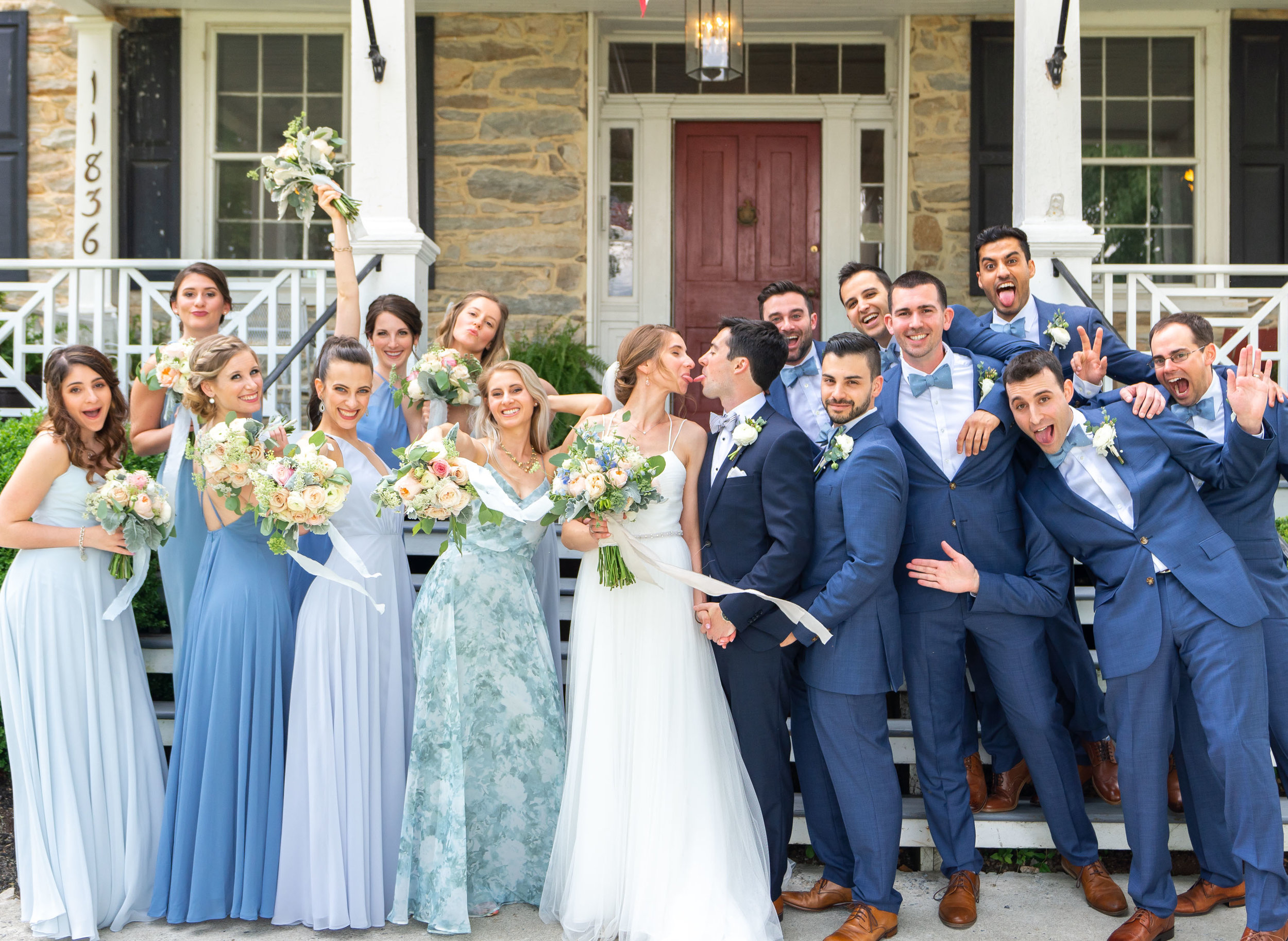 Bridesmaids in light blue dresses from joanna august, jenny you and bhldn. Bride wearing Theia wedding gown