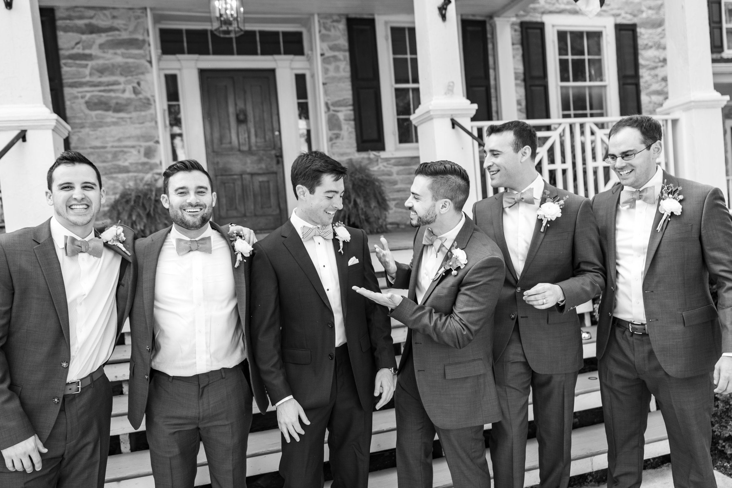 Groom and groomsmen wearing J Crew suits and Tie Bar bow ties at Springfield Manor Winery