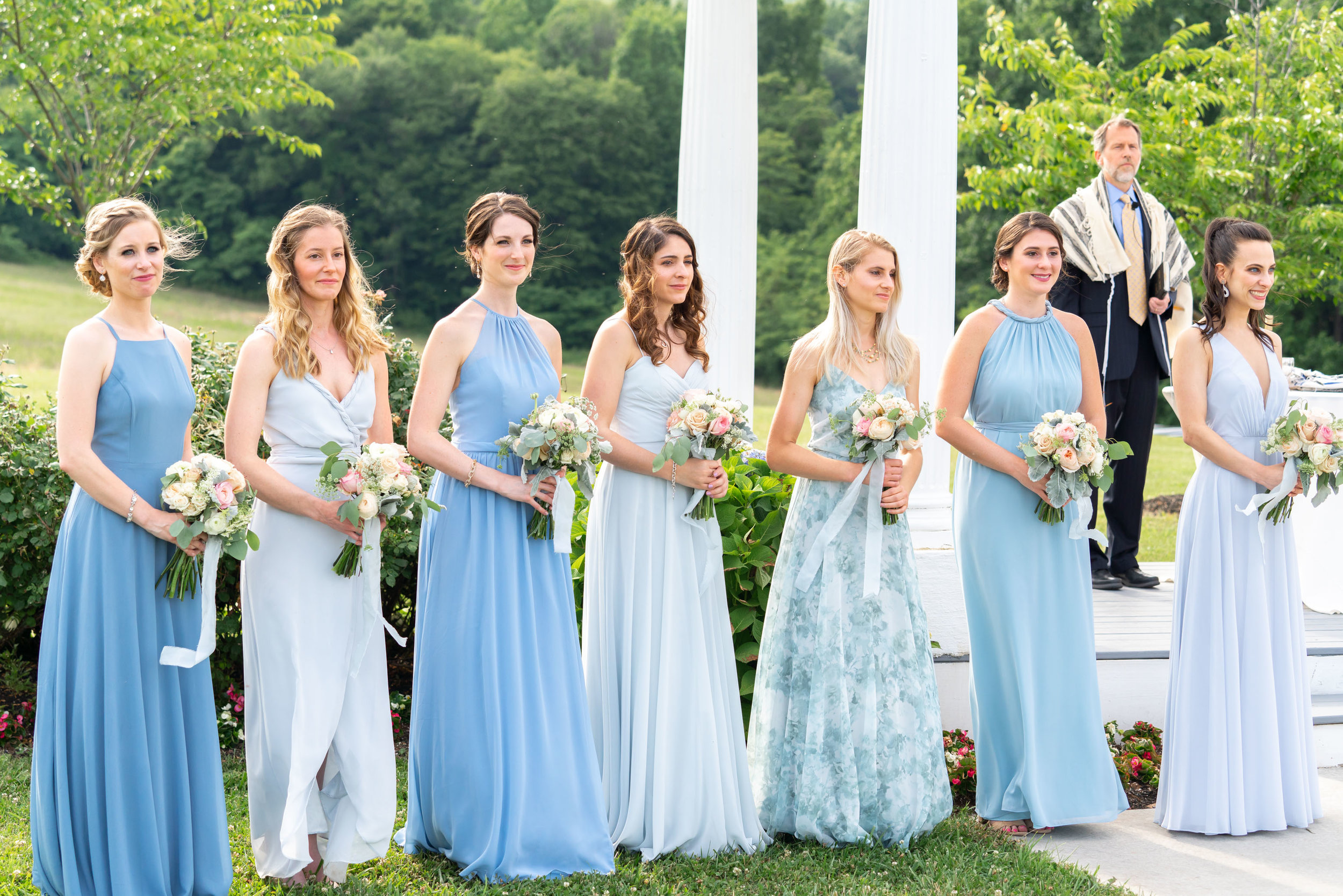 Bridesmaids in light blue dresses from joanna august, jenny you and bhldn. Ceremony site at Springfield Manor
