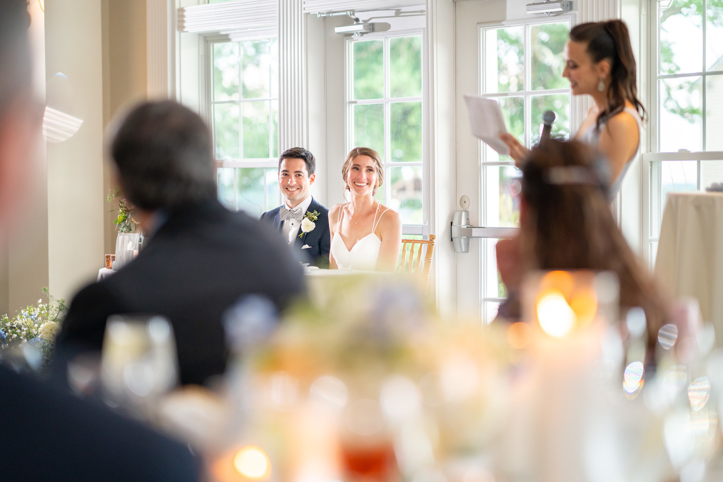 Bridesmaid reading toasts to bride and groom at Springfield Manor Winery and Distillery