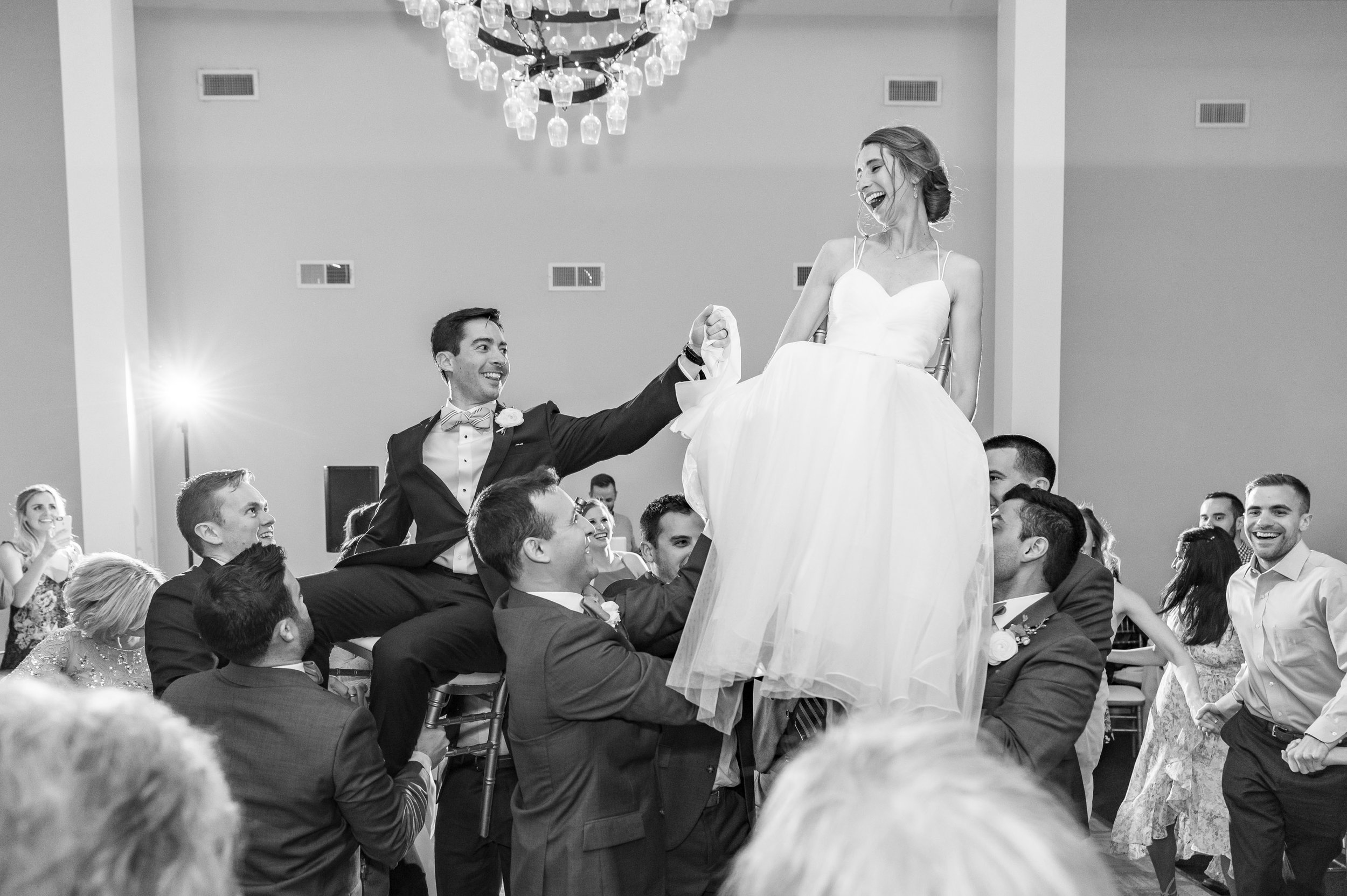 Bride and groom during the hora at Springfield Manor jewish wedding