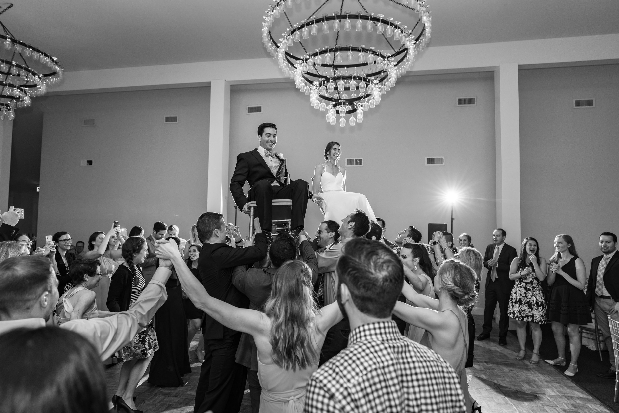 Bride and groom jewish wedding hora in maryland venue