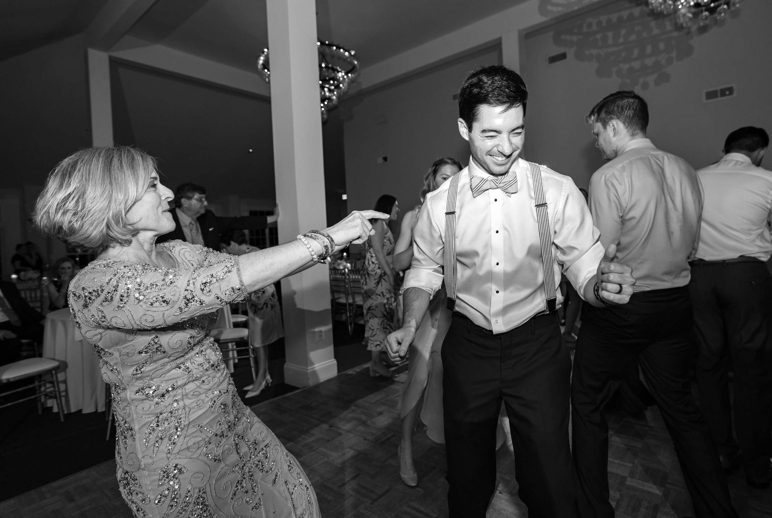 Mother son upbeat dance during wedding reception