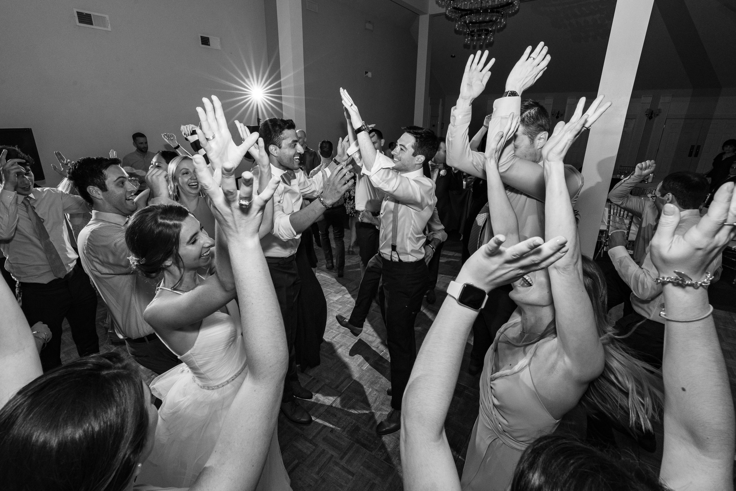 """Wedding guests with hands in the air during """"Shout!"""" song"""