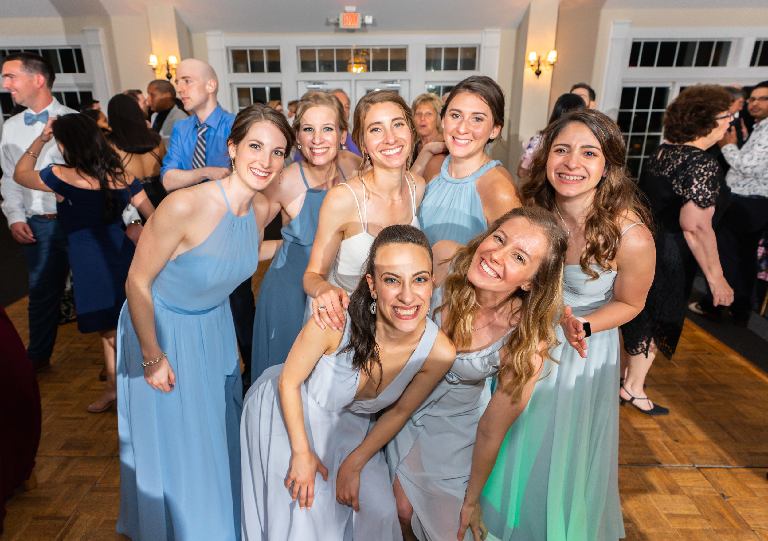 Bride and her bridesmaid squad on the dance floor