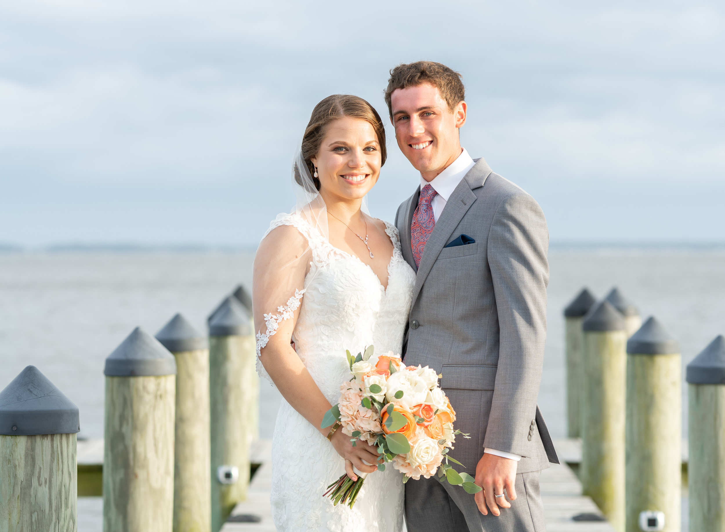 Bride and groom on the dock during sunset at Rehoboth Beach Country Club
