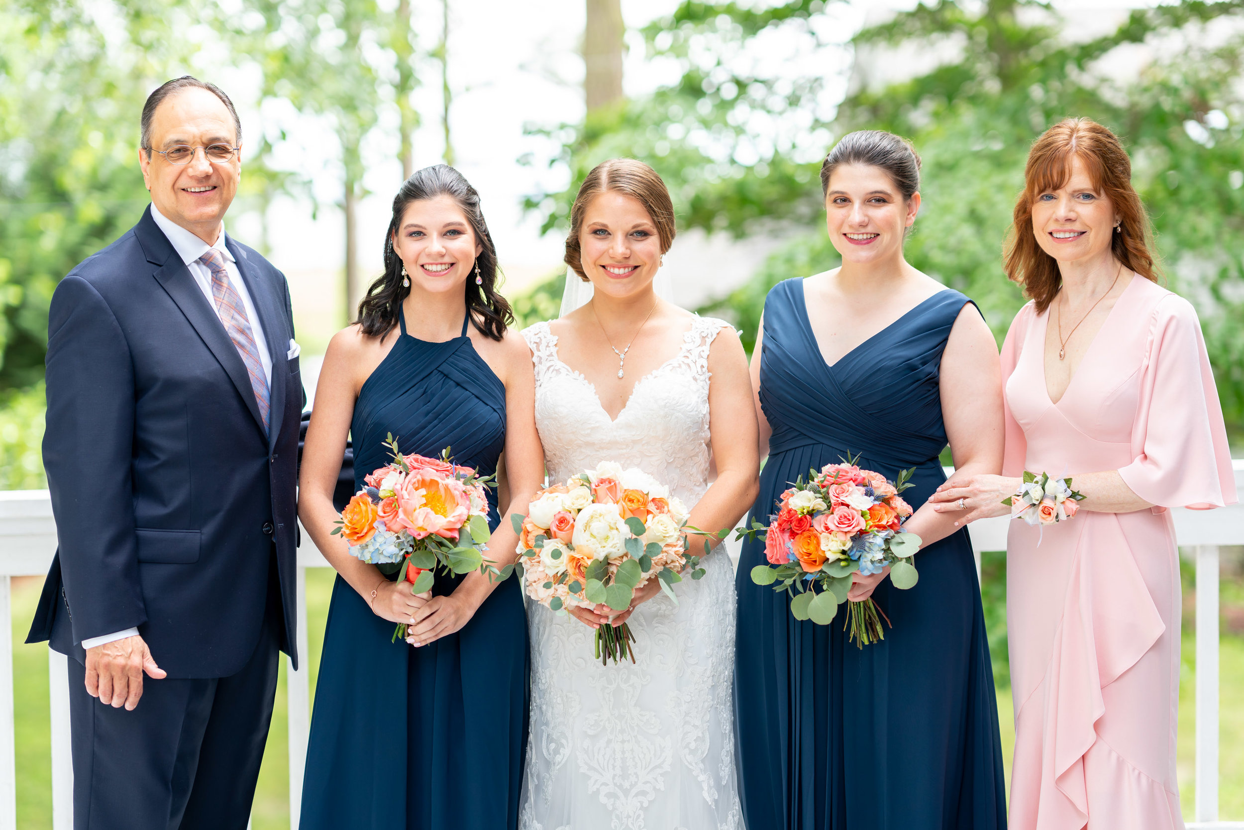 Bride and sisters and parents at Rehoboth Beach Country Club wedding