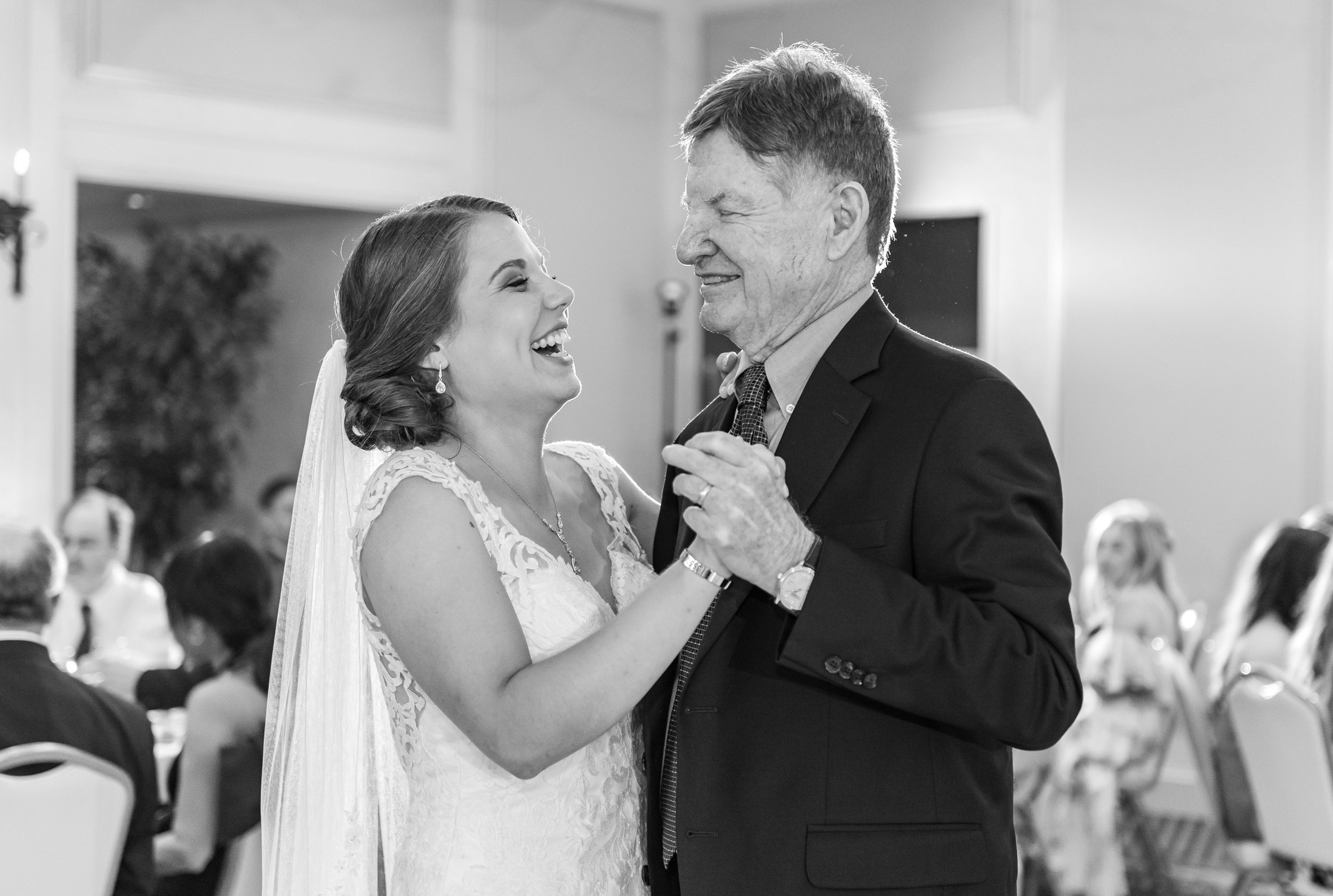 Bride laughs and dances with grandpa at Rehoboth Beach Country Club