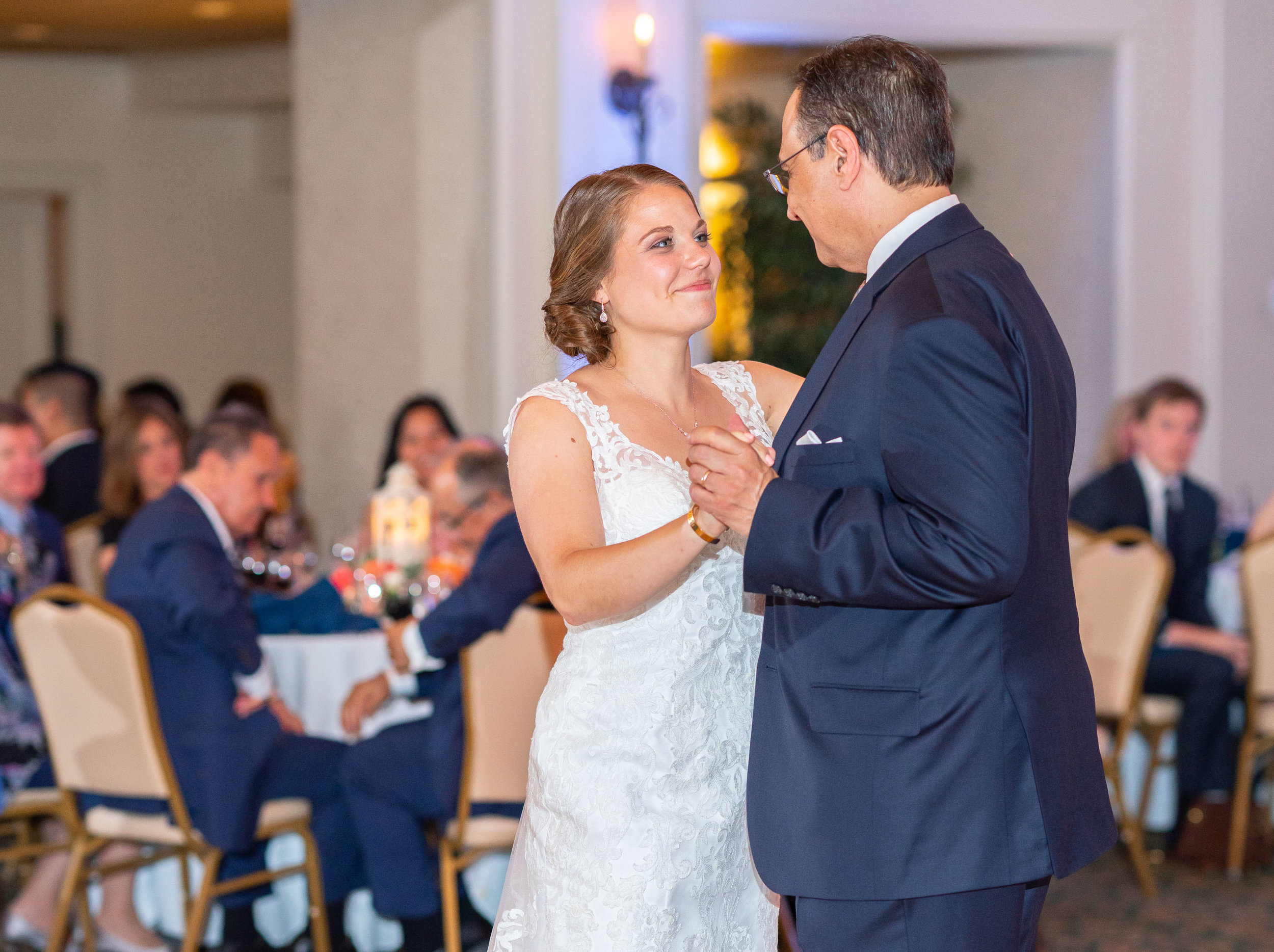 Father daughter dance in evening ballroom during wedding reception at Rehoboth Beach Country Club