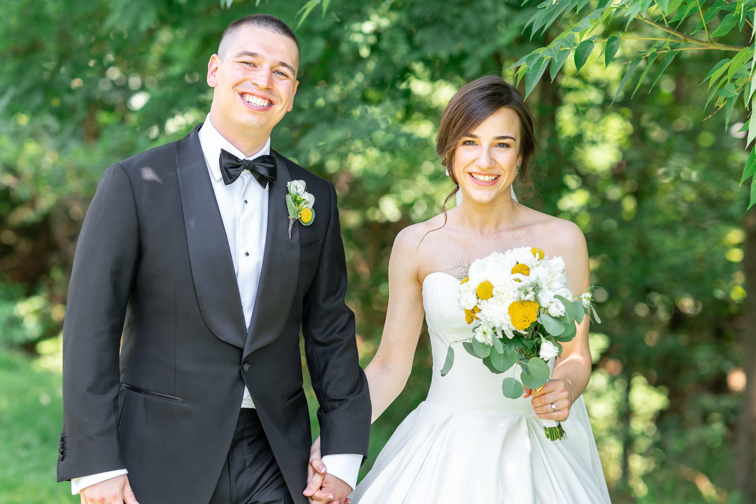 Bride and groom walking at Luray wedding in Shenandoah mountains
