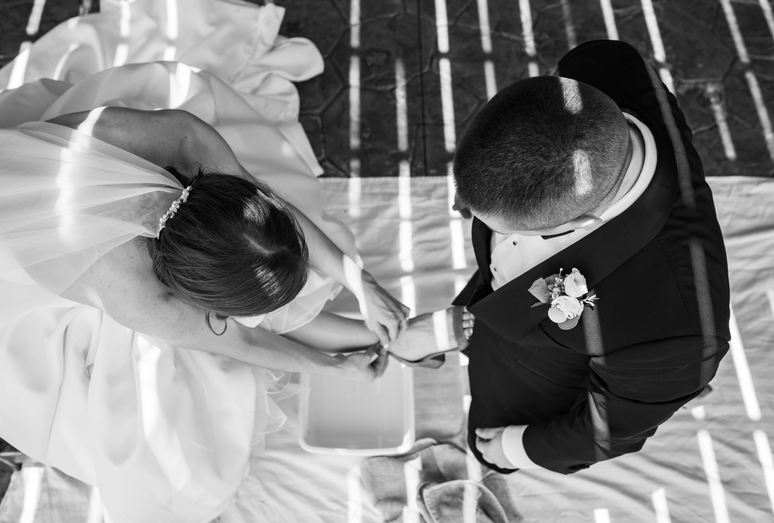 Groom washes brides feet after wedding ceremony