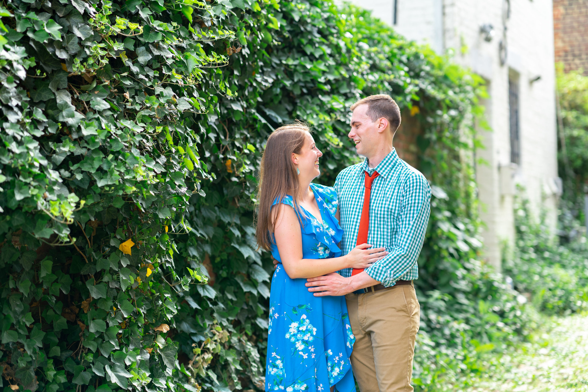 bride and groom hugging in cobblestone alley in old town alexandria