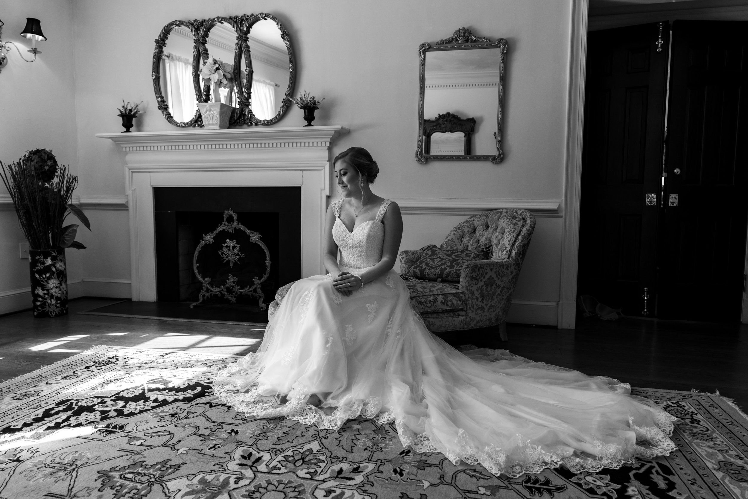 Bride in bridal suite sitting on sofa at Stone Manor Country Club
