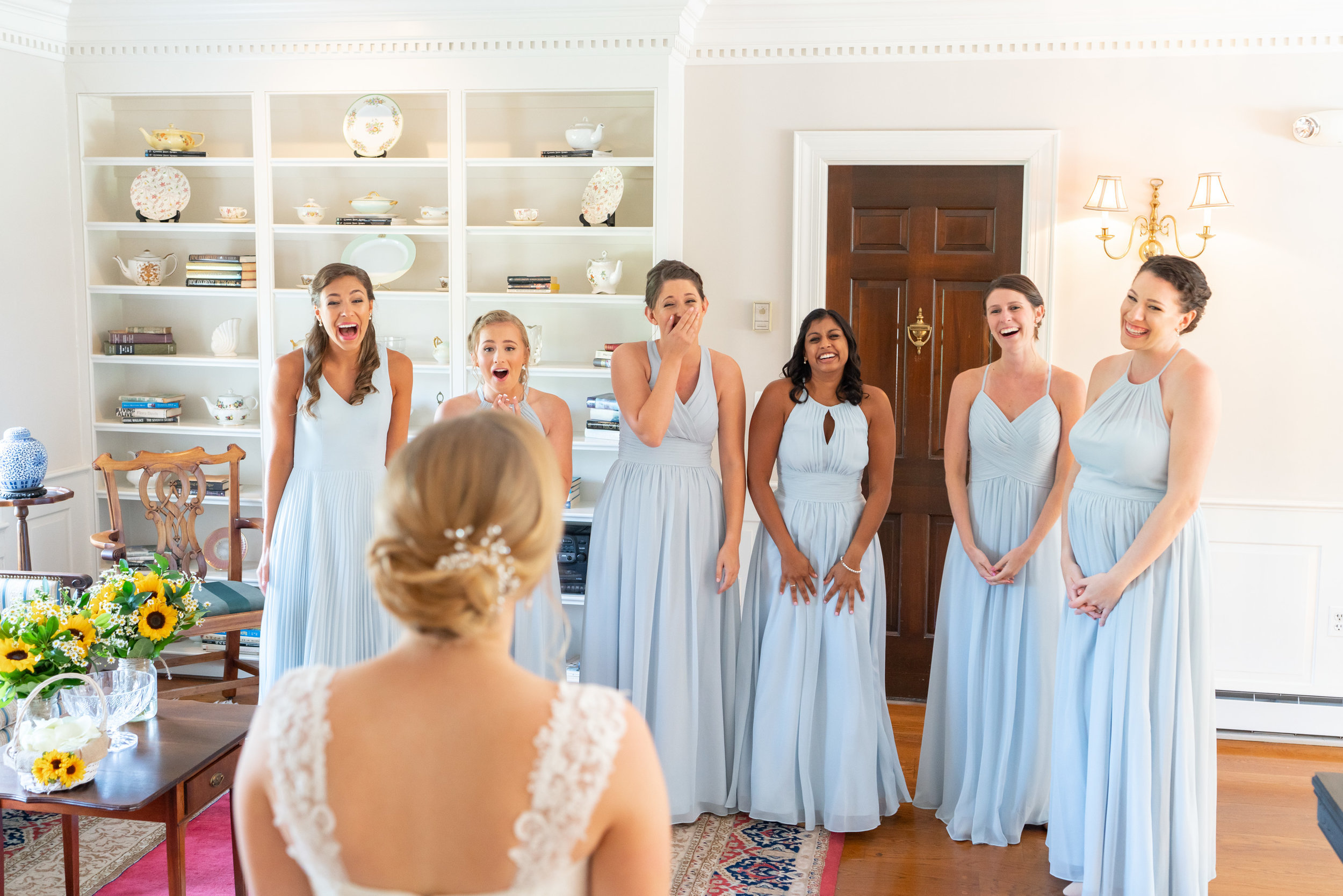 Bridesmaids in light blue azazie dresses at Stone Manor Country Club
