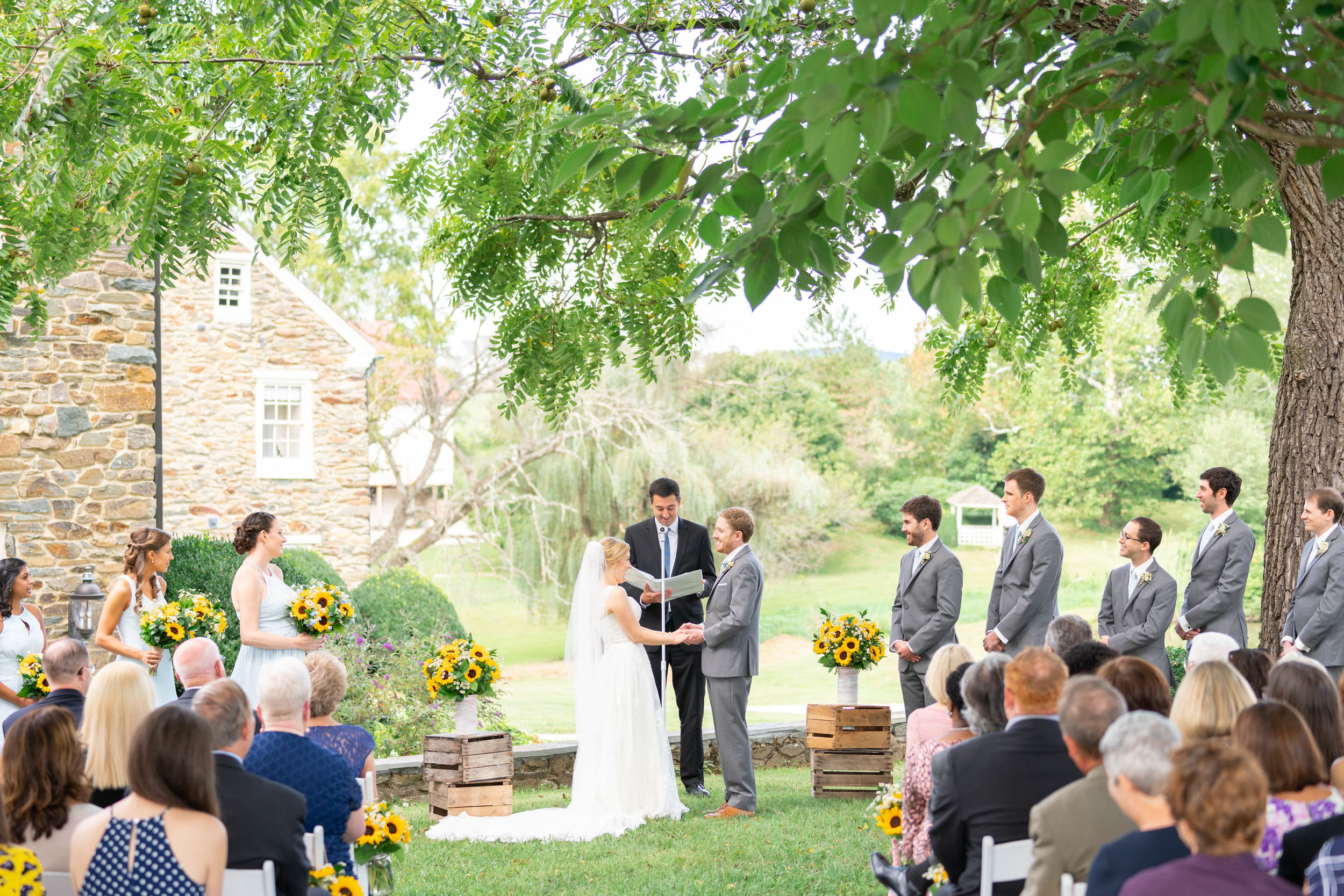 Outdoor ceremony overlooking lake at Stone Manor Country Club wedding