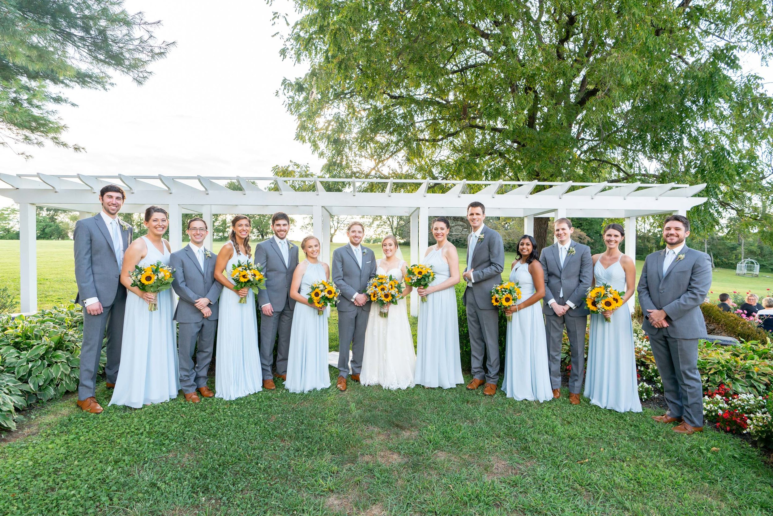 Bridal party with bridesmaids and groomsmen at Stone Manor Country Club