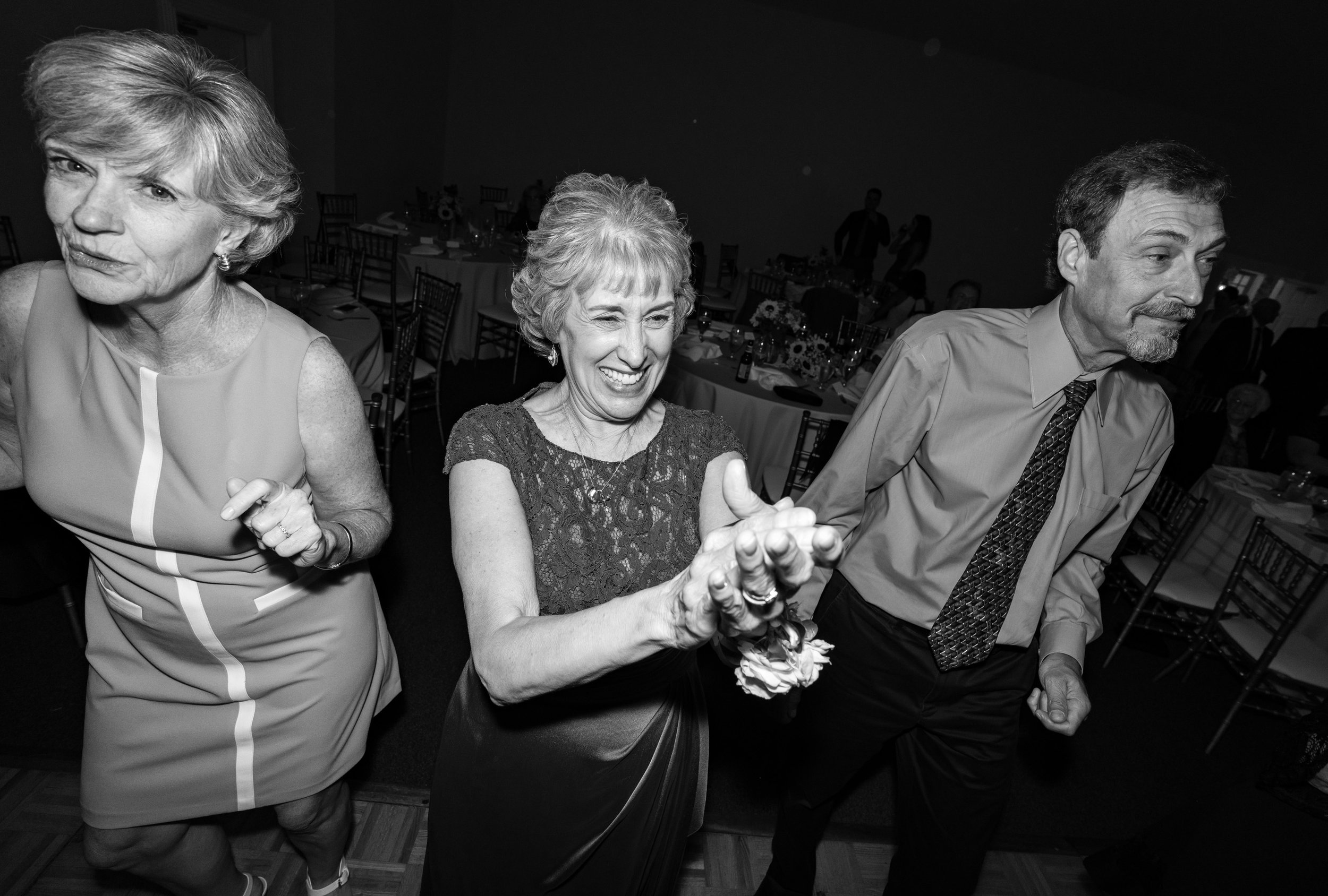 mother and family laughing on the dance floor at stone manor country club