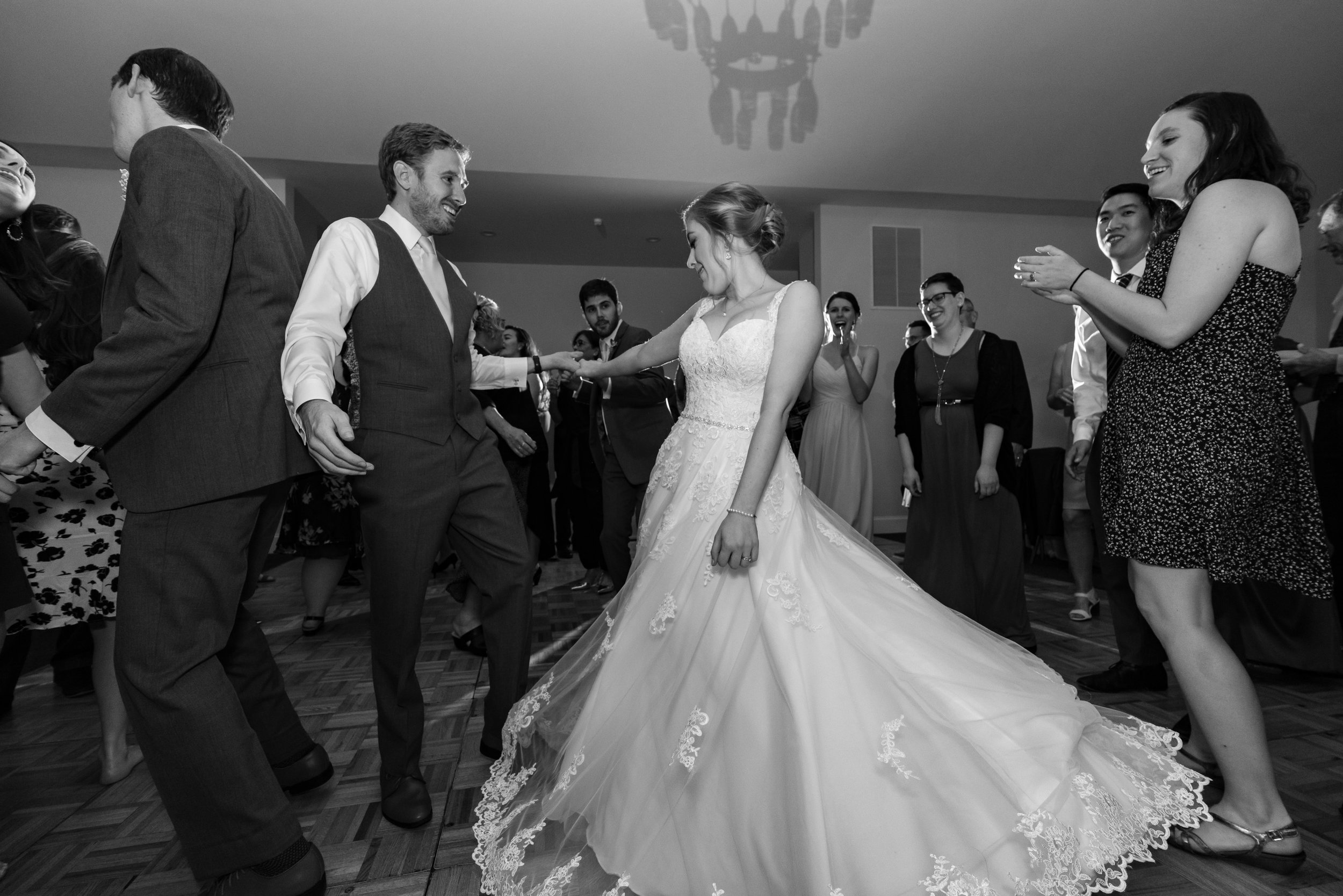 groom spinning bride on the dance floor at stone manor country club